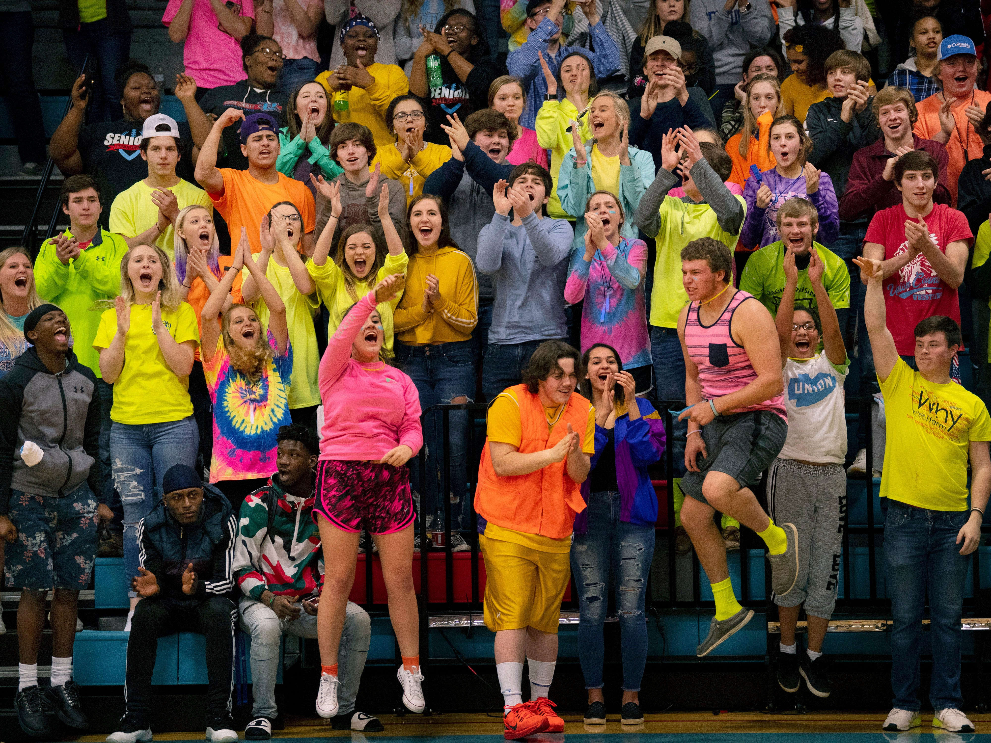 The Union County student section erupts after a big basket by their boys basketball team salted away the game against Henderson County at Union County High School Monday night. The Braves snapped their 16-game losing streak against the Colonels.