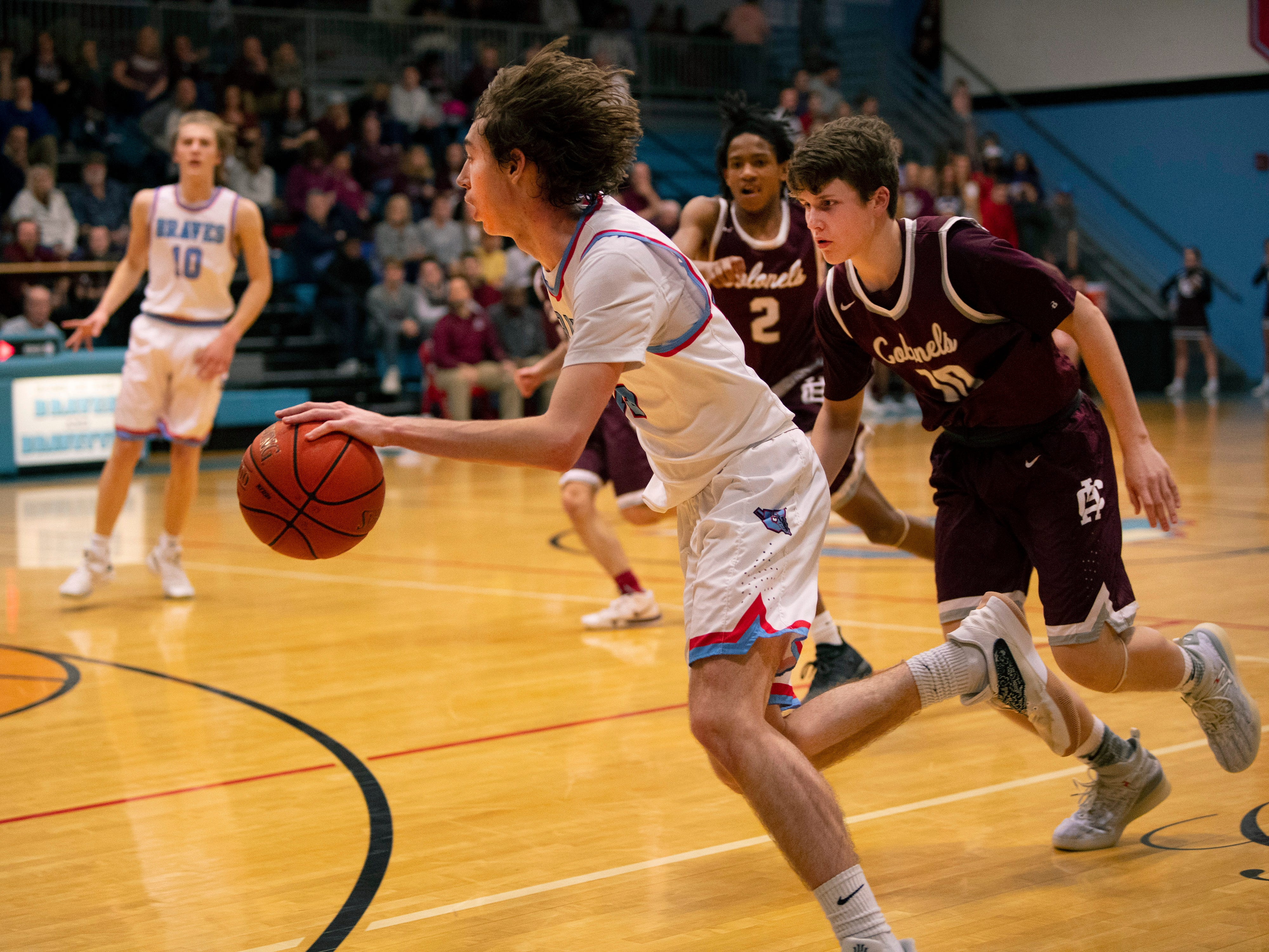 Union County's Elex Dunford (15) drives against against Henderson County at Union County High School Monday night.