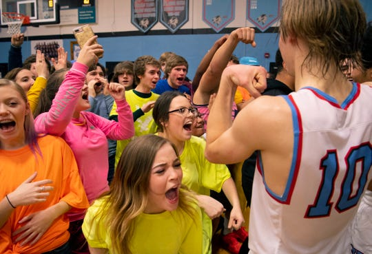 The Union County student section celebrates with their boys basketball team after beating Henderson County at Union County High School Monday night. The Braves snapped their 16-game losing streak against the Colonels.