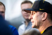 Iowa baseball head coach Rick Heller talks with reporters during Hawkeye baseball media day on Tuesday, Feb. 5, 2019, in Iowa City, Iowa.