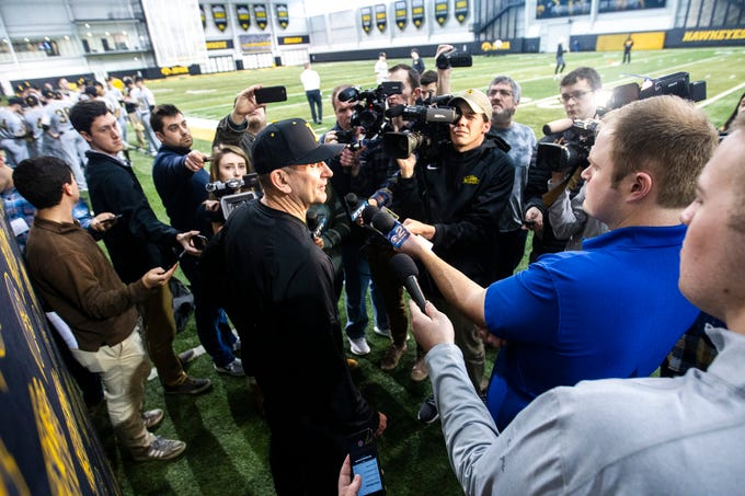 Iowa baseball head coach Rick Heller talks with reporters during Hawkeye baseball media day on Tuesday, Feb. 5, 2019, in Iowa City, Iowa.