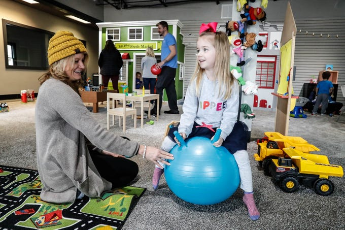 Ali Coulom and her daughter Leslie Coulom play together at The Little Village Playroom, 9850 N. Michigan Rd, Carmel, Ind., on Tuesday, Feb. 5, 2019.
