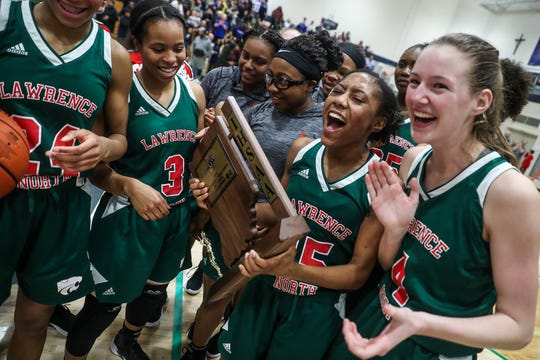 The Lawrence North Wildcats celebrate winning the Class 4A sectional title at Cathedral High School in Indianapolis, Monday, Feb. 4, 2019. Lawrence North defeated Heritage Christian, 55-50.