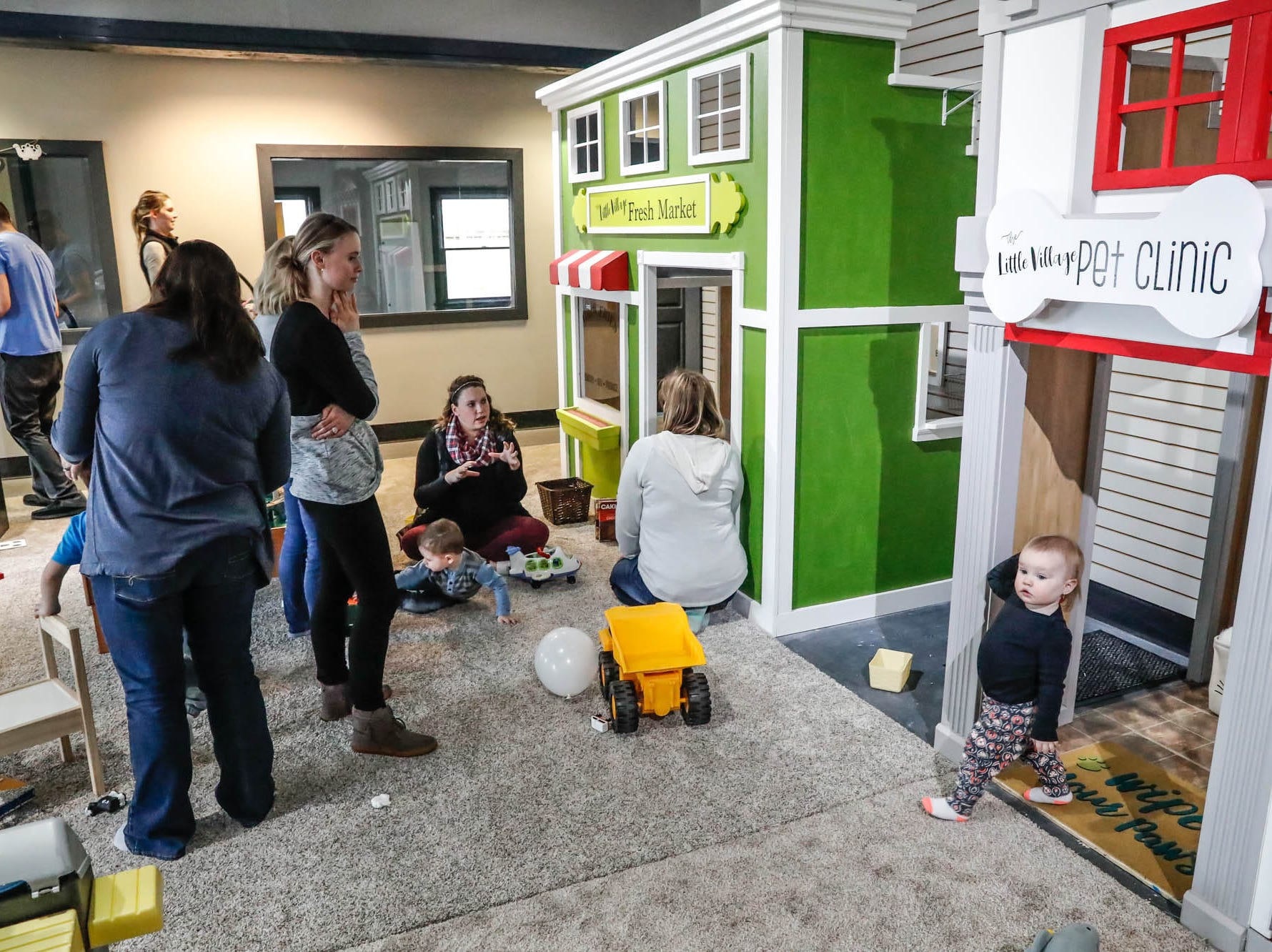 Caregivers and children play in The Little Fresh Market and the Little Village Pet Clinic play houses at The Little Village Playroom, 9850 N. Michigan Rd, Carmel, Ind., on Tuesday, Feb. 5, 2019. The Play Room offers caregivers offers free coffee and free wifi to work or check emails.