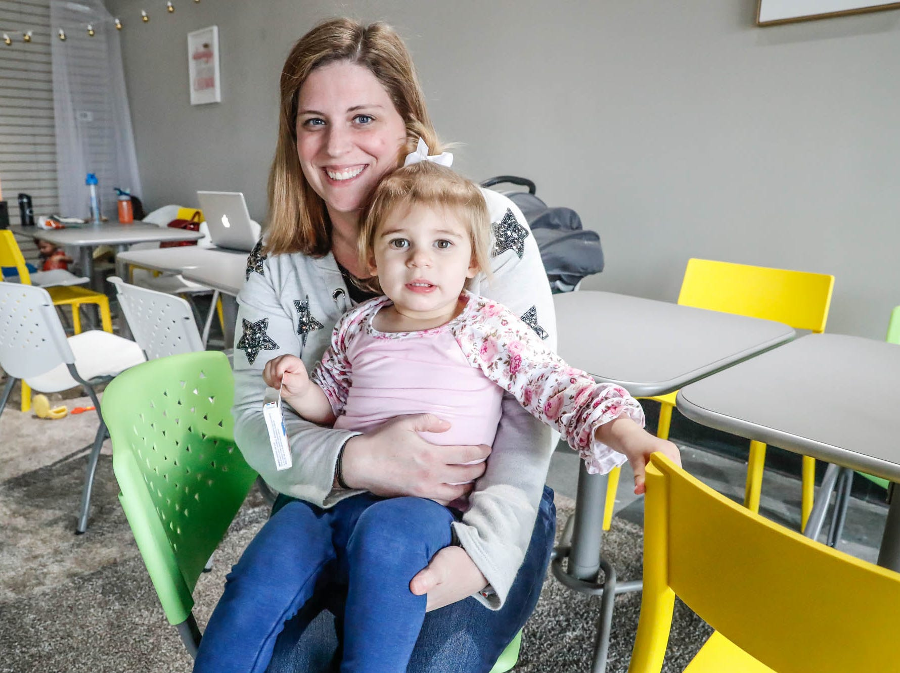 Becca Freidman, right, plays with her daughter Maddison Freidman sit at a cafe table in The Little Village Playroom, 9850 N. Michigan Rd, Carmel, Ind., on Tuesday, Feb. 5, 2019. The Play Room offers caregivers offers free coffee and free wifi to work or check emails.