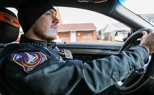 IMPD officer Jeremy Torres patrols the Towne and Terrace housing complex off of 42nd Street and Post Road, on Saturday, Dec. 8, 2018. Over time, the deteriorating complex has become concentrated with systematic crime and violence. Since 2013, seven criminal homicide victims have been found at the complex.