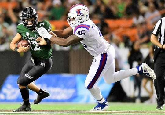 Dec 22, 2018; Honolulu, HI, USA; Louisiana Tech Bulldogs defensive end Jaylon Ferguson (45) sacked Hawaii Warriors quarterback Chevan Cordeiro (12) during the third quarter of the SoFi Hawaii Bowl between the Louisiana Tech Bulldogs and the Hawaii Warriors played at Aloha Stadium. Louisiana Tech won 31-14.
