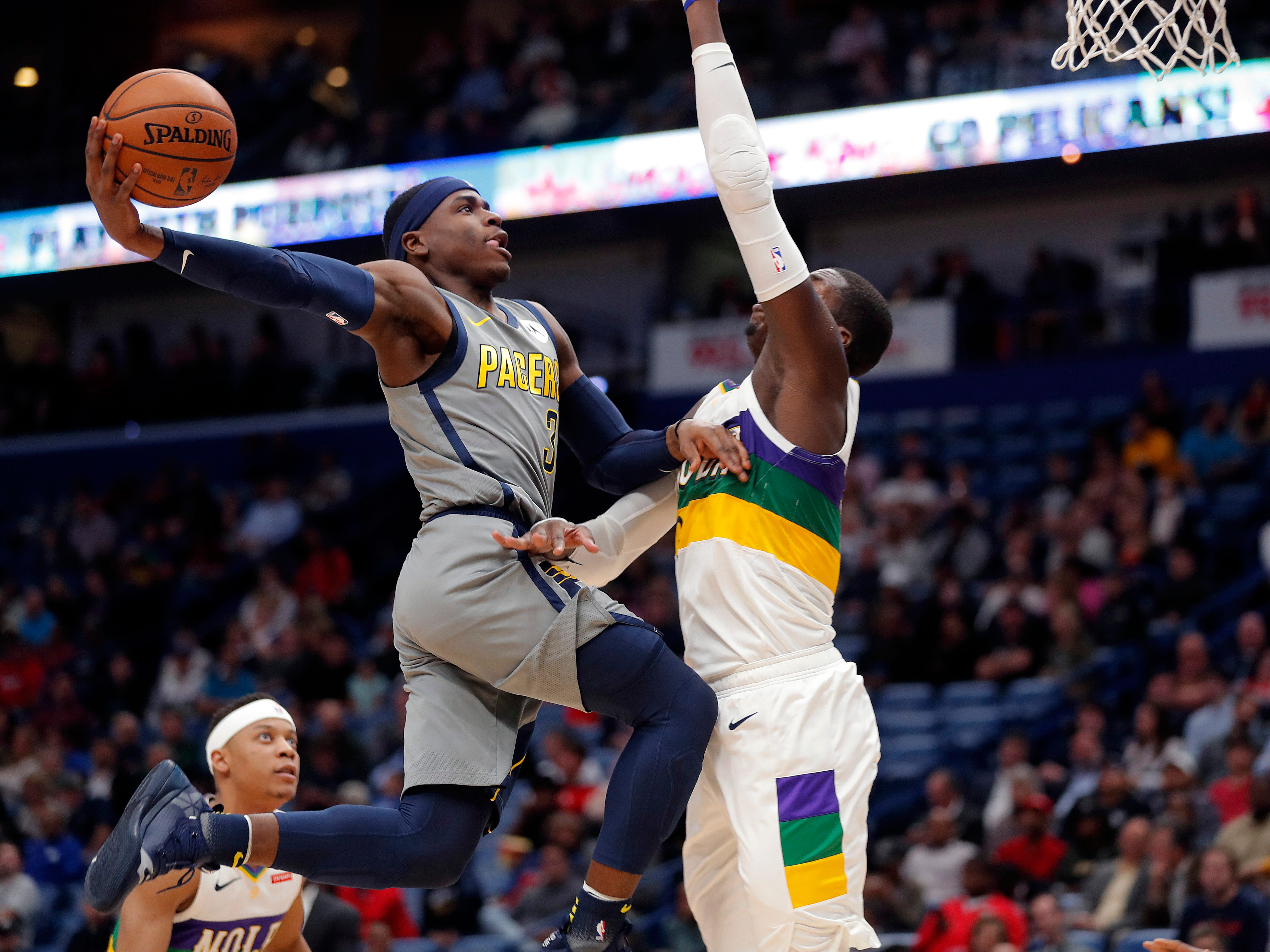 Indiana Pacers guard Aaron Holiday (3) goes to the basket against New Orleans Pelicans forward Cheick Diallo in the first half of an NBA basketball game in New Orleans, Monday, Feb. 4, 2019.