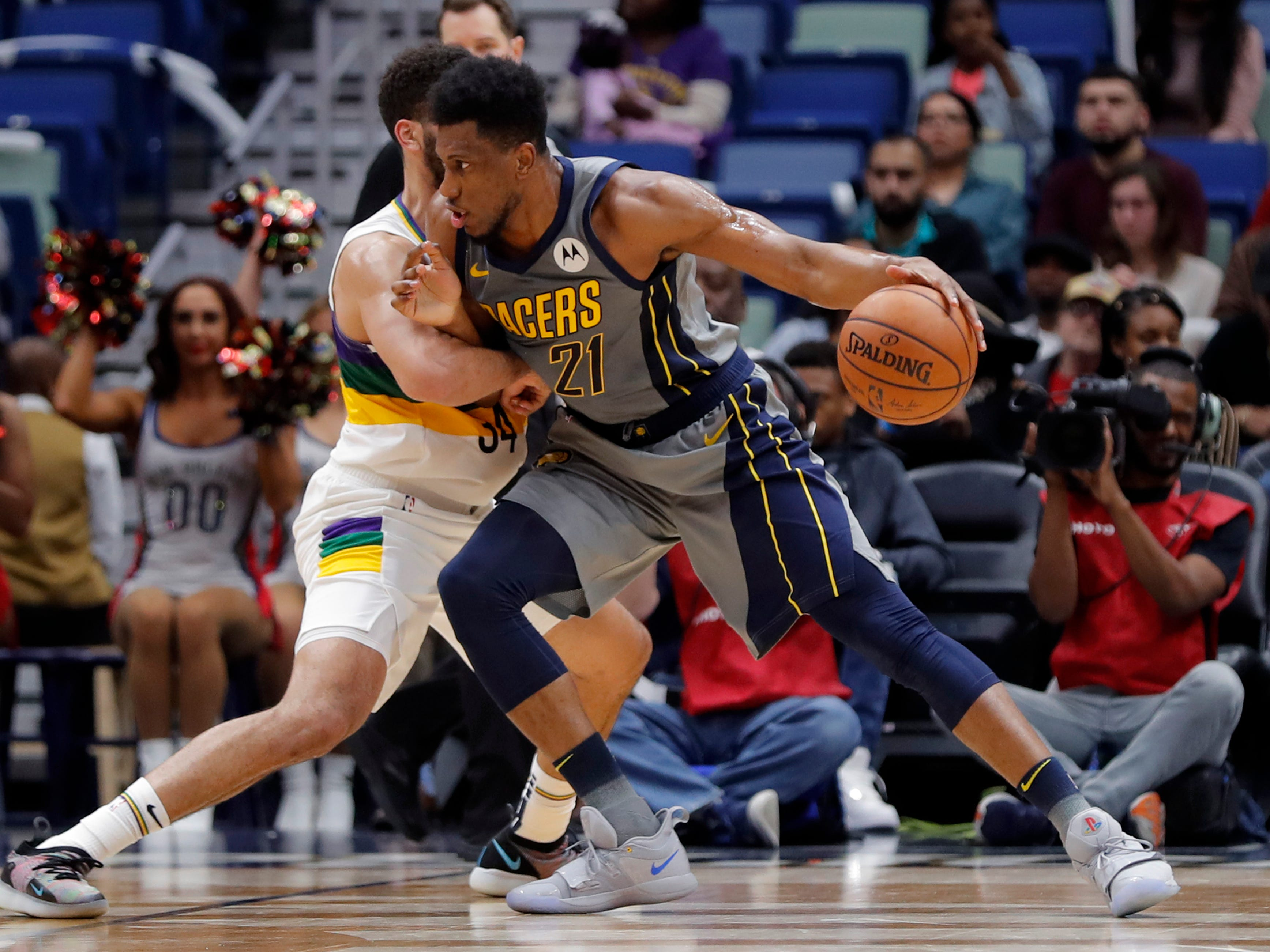Indiana Pacers forward Thaddeus Young (21) drives to the basket against New Orleans Pelicans guard Kenrich Williams (34) in the first half of an NBA basketball game in New Orleans, Monday, Feb. 4, 2019.