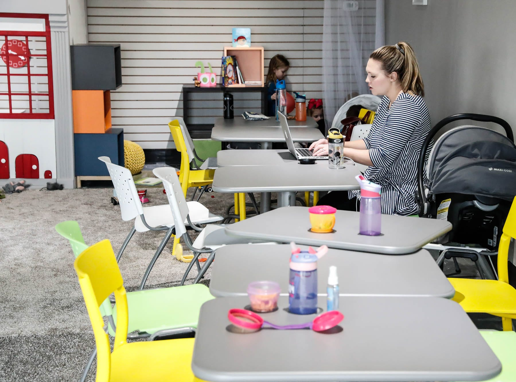 Mom Emelie Russell works on her computer while watching her child at The Little Village Playroom, 9850 N. Michigan Rd, Carmel, Ind., on Tuesday, Feb. 5, 2019.