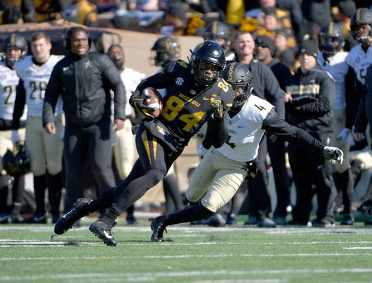 Nov 10, 2018; Columbia, MO, USA; Missouri Tigers wide receiver Emanuel Hall (84) runs the ball as Vanderbilt Commodores defensive back Randall Haynie (4) attempts the tackle during the first half at Memorial Stadium/Faurot Field.