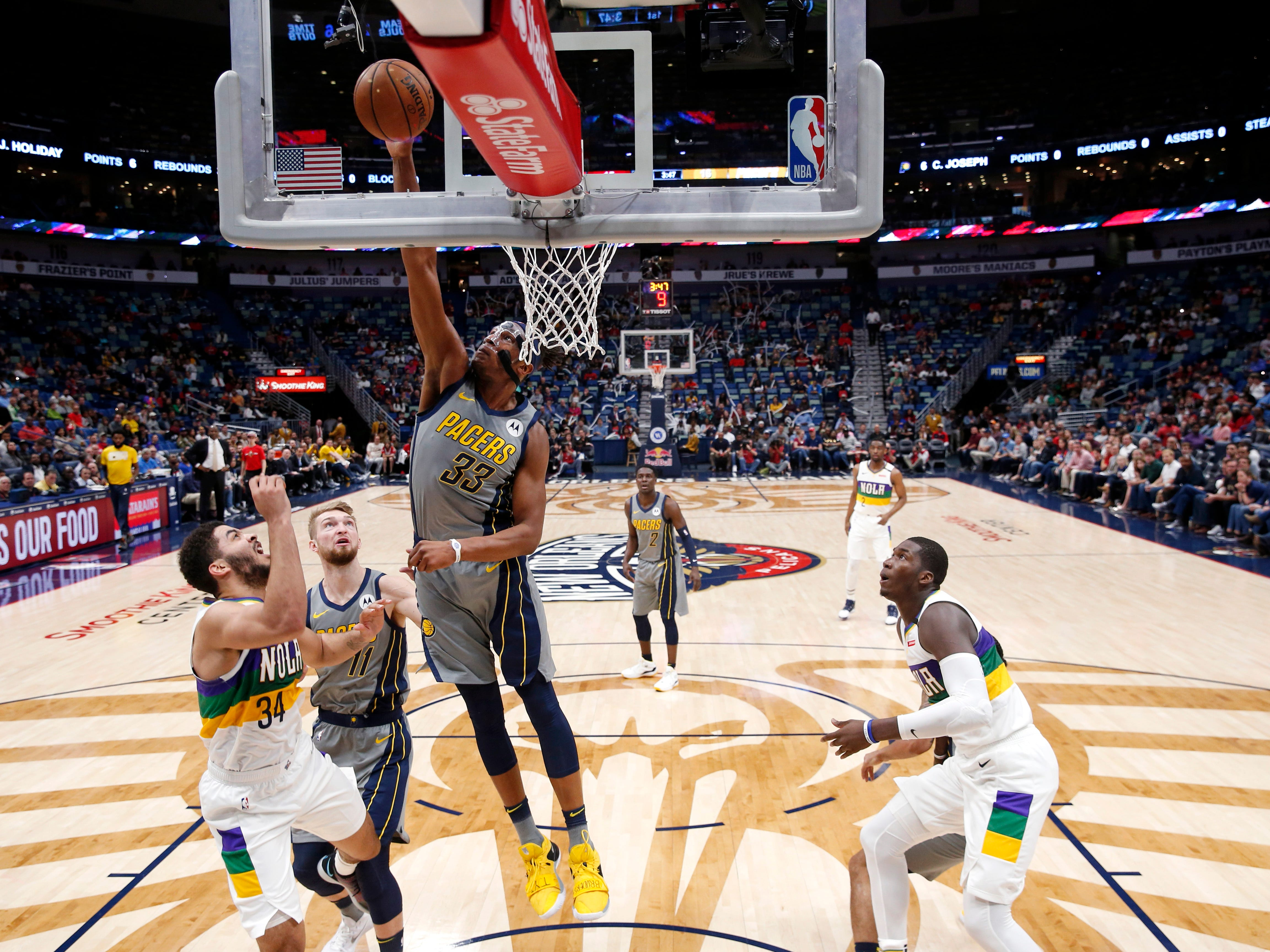 Indiana Pacers center Myles Turner (33) pulls down rebound over New Orleans Pelicans guard Kenrich Williams (34) in the first half of an NBA basketball game in New Orleans, Monday, Feb. 4, 2019.