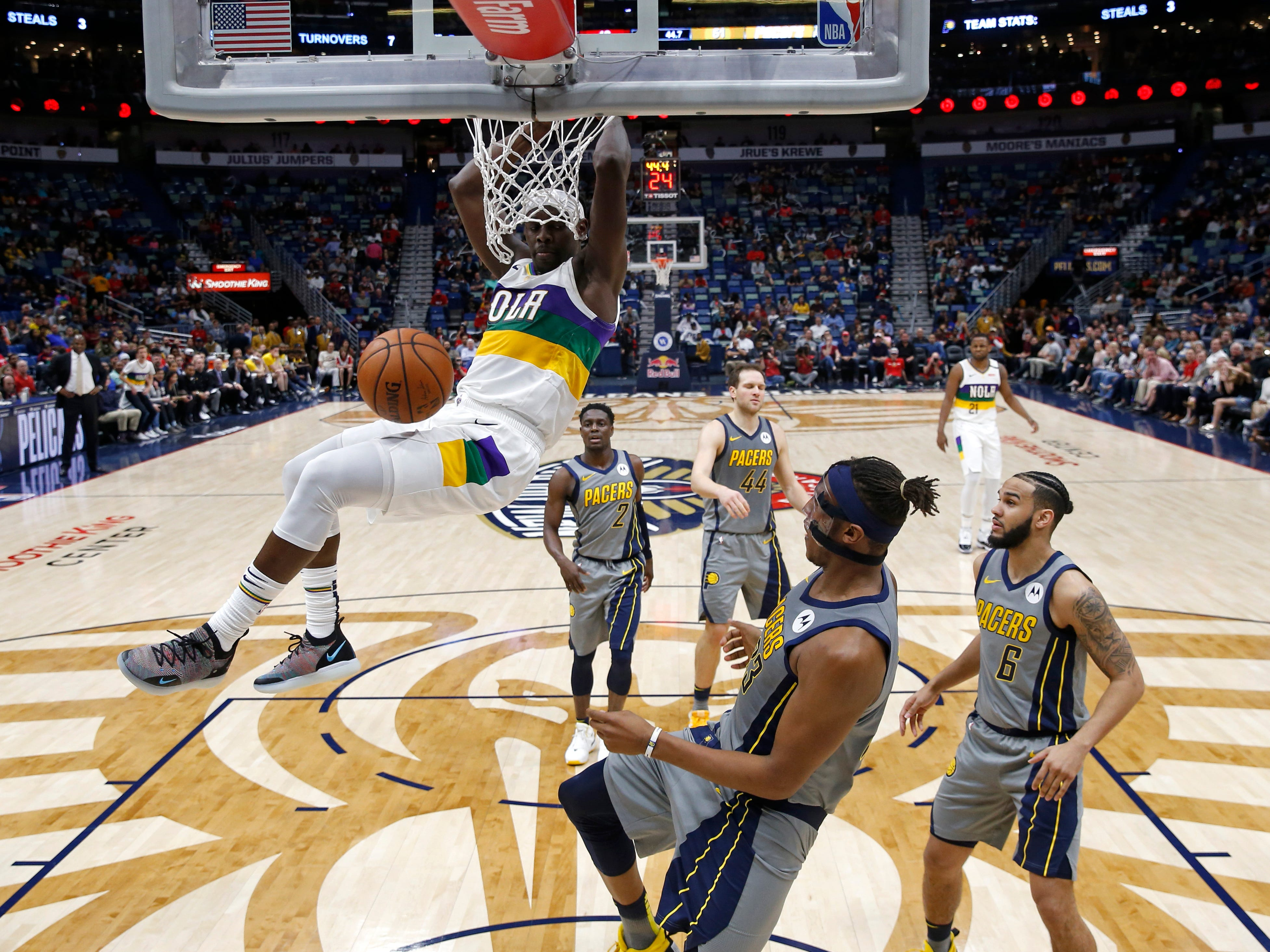 New Orleans Pelicans guard Jrue Holiday slam dunks in the first half of an NBA basketball game against the Indiana Pacers in New Orleans, Monday, Feb. 4, 2019.