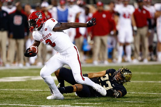 Nov 18, 2017; Winston-Salem, NC, USA; North Carolina State Wolfpack wide receiver Kelvin Harmon (3) runs after a catch in the fourth quarter against the Wake Forest Demon Deacons at BB&T Field.