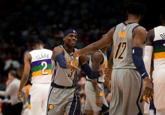 Feb 4, 2019; New Orleans, LA, USA; Indiana Pacers guard Aaron Holiday (3) celebrates with guard Tyreke Evans (12) during the first quarter against the New Orleans Pelicans at the Smoothie King Center.