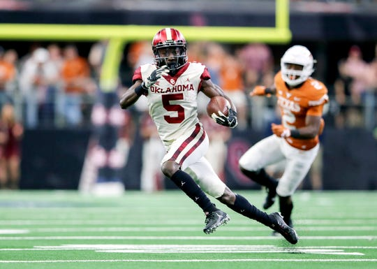 Dec 1, 2018; Arlington, TX, USA; Oklahoma Sooners wide receiver Marquise Brown (5) runs during the game against the Texas Longhorns in the Big 12 Championship game at AT&T Stadium.