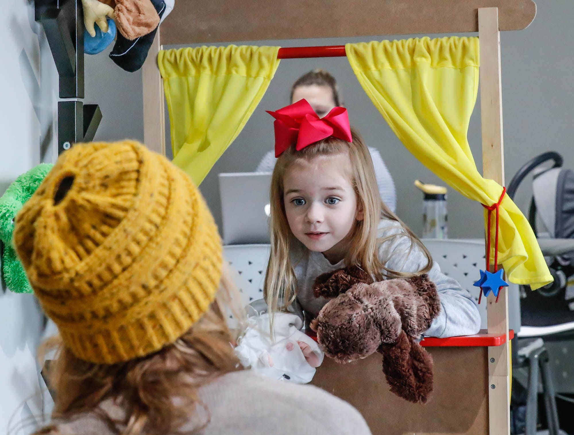 Ali Coulom, left, and her daughter Leslie Coulom play with a puppet theatre at The Little Village Playroom, 9850 N. Michigan Rd, Carmel, Ind., on Tuesday, Feb. 5, 2019.