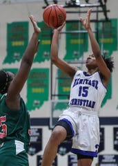 Heritage Christian Eagles Sydney Watkins (15) shoots during the second half of the Class 4A sectional at Cathedral High School in Indianapolis, Monday, Feb. 4, 2019. Lawrence North took the title, 55-50.