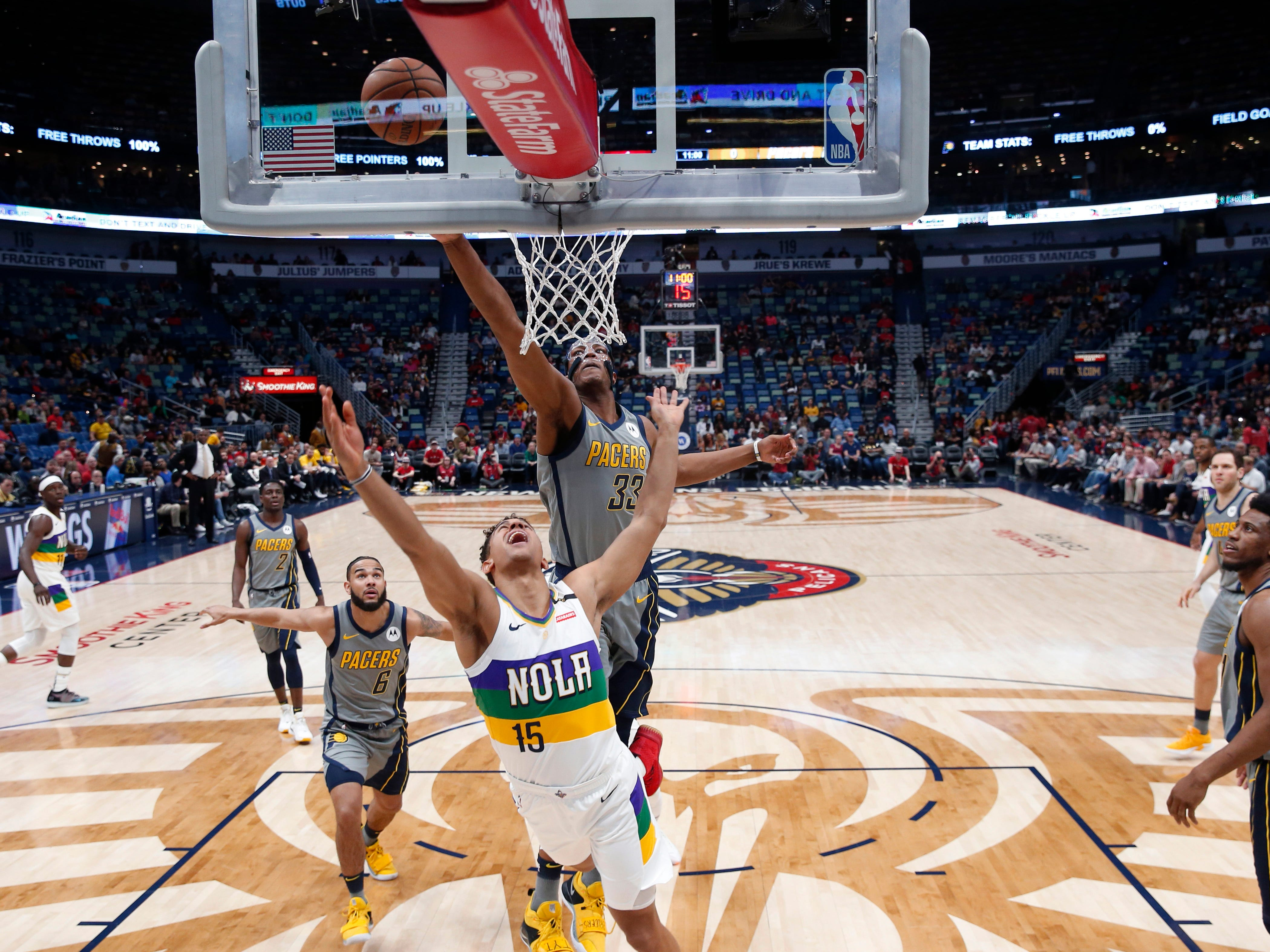 Indiana Pacers center Myles Turner (33) tries to block a shot by New Orleans Pelicans guard Frank Jackson (15) in the first half of an NBA basketball game in New Orleans, Monday, Feb. 4, 2019.