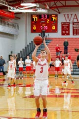 Jack Davidson shoots a free throw inside Chadwick Court during a Wabash College basketball game.