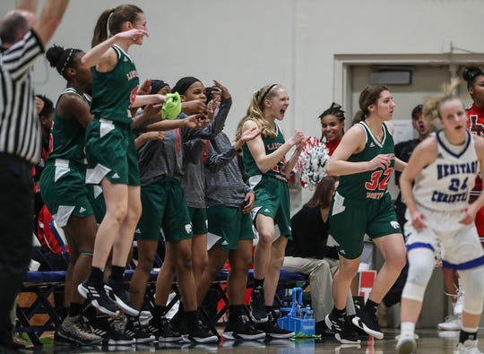 The Lawrence North Wildcats celebrate three points by Katie Davidson (32) during the second half of the Class 4A sectional at Cathedral High School in Indianapolis, Monday, Feb. 4, 2019. Lawrence North took the title, 55-50.