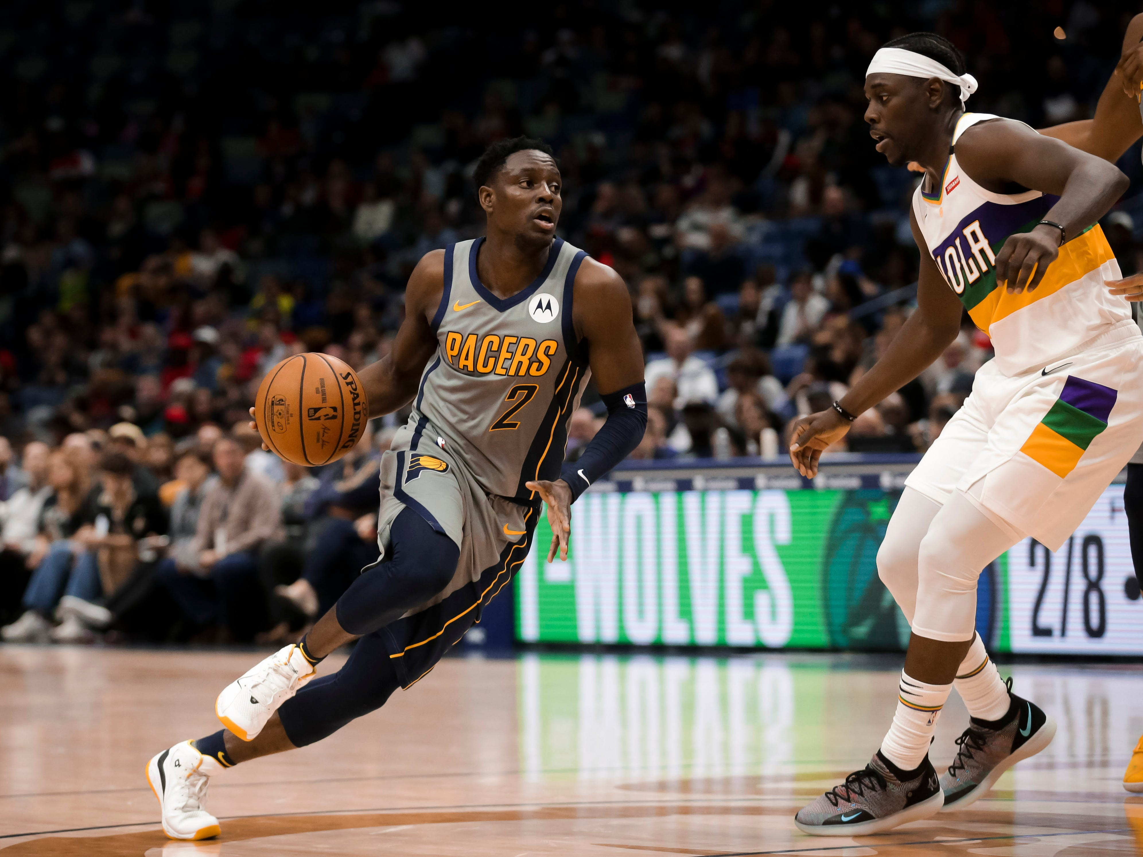 Feb 4, 2019; New Orleans, LA, USA; Indiana Pacers guard Darren Collison (2) drives in against New Orleans Pelicans guard Jrue Holiday (11) during the second quarter at the Smoothie King Center.