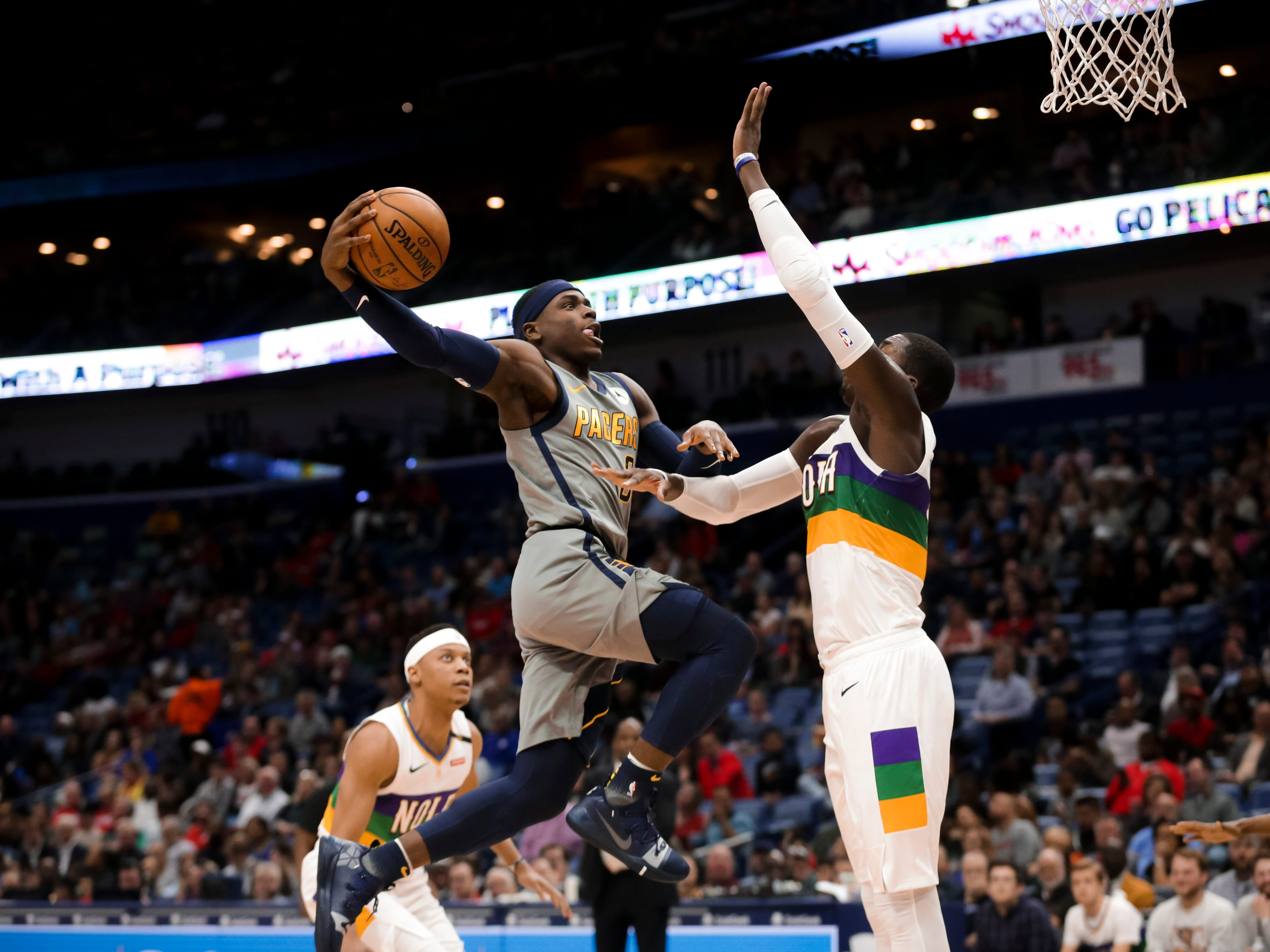 Feb 4, 2019; New Orleans, LA, USA; Indiana Pacers guard Aaron Holiday (3) attempts a dunk New Orleans Pelicans forward Cheick Diallo (13) during the first quarter at the Smoothie King Center.
