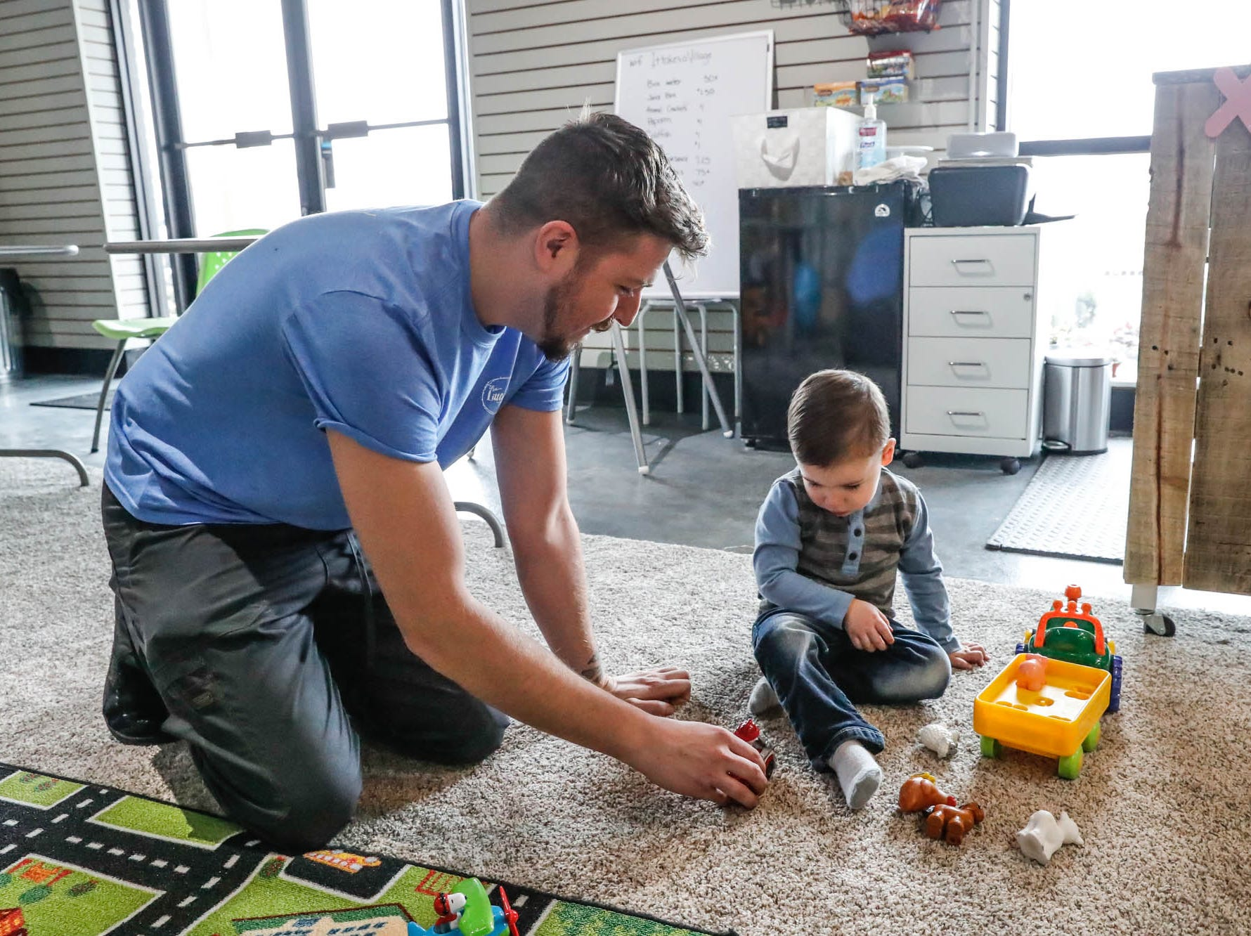 Staff member, Craig Smith, left, plays cars with Barrett Richards at The Little Village Playroom, 9850 N. Michigan Rd, Carmel, Ind., on Tuesday, Feb. 5, 2019.