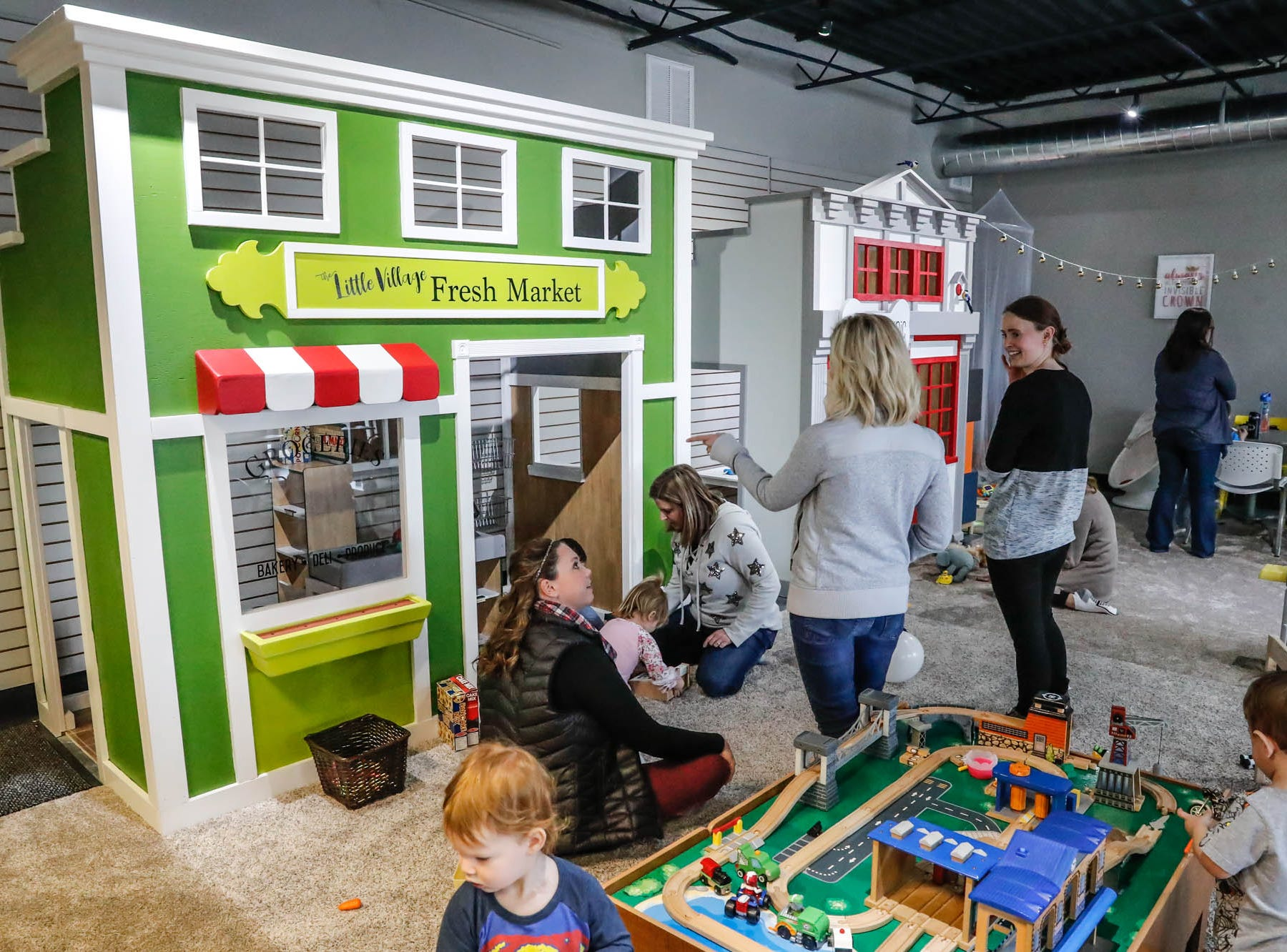 Caregivers and children play in The Little Fresh Market play house at The Little Village Playroom, 9850 N. Michigan Rd, Carmel, Ind., on Tuesday, Feb. 5, 2019. The Play Room offers caregivers offers free coffee and free wifi to work or check emails.
