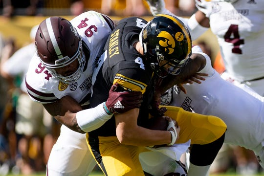 Jan 1, 2019; Tampa, FL, USA; Iowa Hawkeyes quarterback Nate Stanley (4) is sacked by Mississippi State Bulldogs defensive tackle Jeffery Simmons (94) during the first quarter in the 2019 Outback Bowl at Raymond James Stadium.