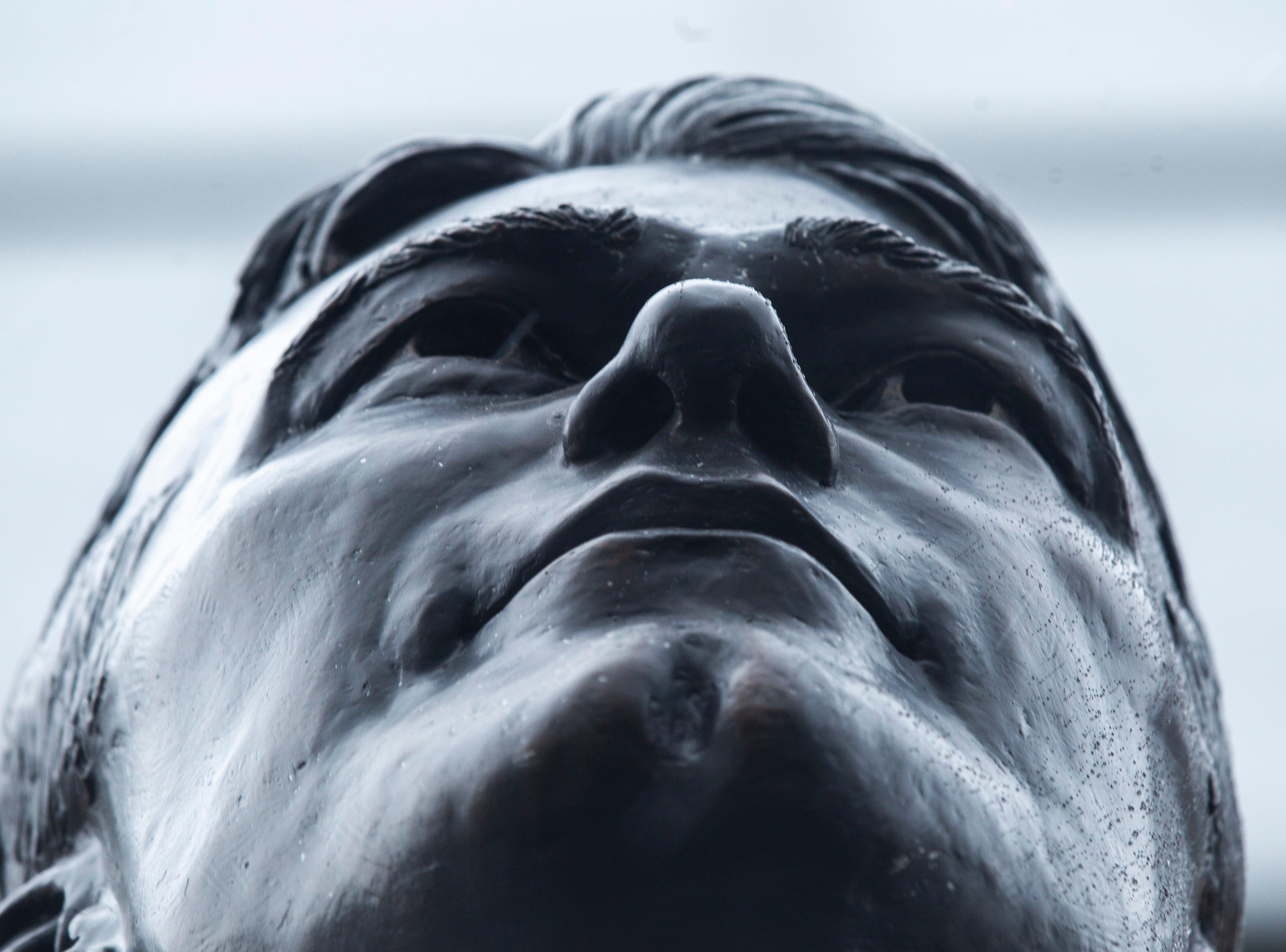Freezing rain falls on a statue of Nile Kinnick, Tuesday, Feb. 5, 2019, in Iowa City, Iowa.