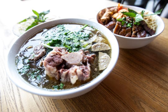 Pho Saigon's Corner with ox tail, meat balls and beef tendon and Vermicelli special with egg roll, pork chop, pork skin, shrimp and vegetables are seen Monday, Feb. 4, 2019, at Saigon's Corner in the Old Capitol Town Center in Iowa City, Iowa.