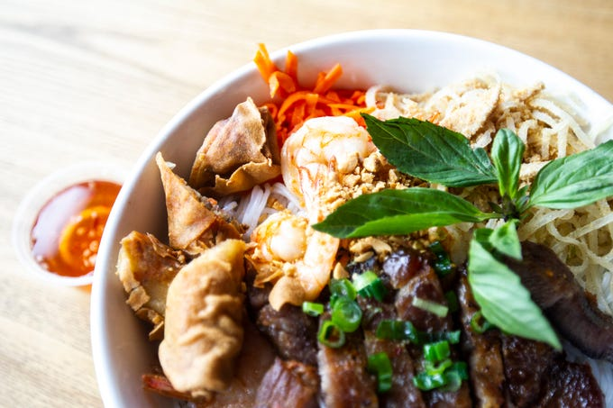 Vermicelli special with egg roll, pork chop, pork skin, shrimp and vegetables is seen Monday, Feb. 4, 2019, at Saigon's Corner in the Old Capitol Town Center in Iowa City, Iowa.