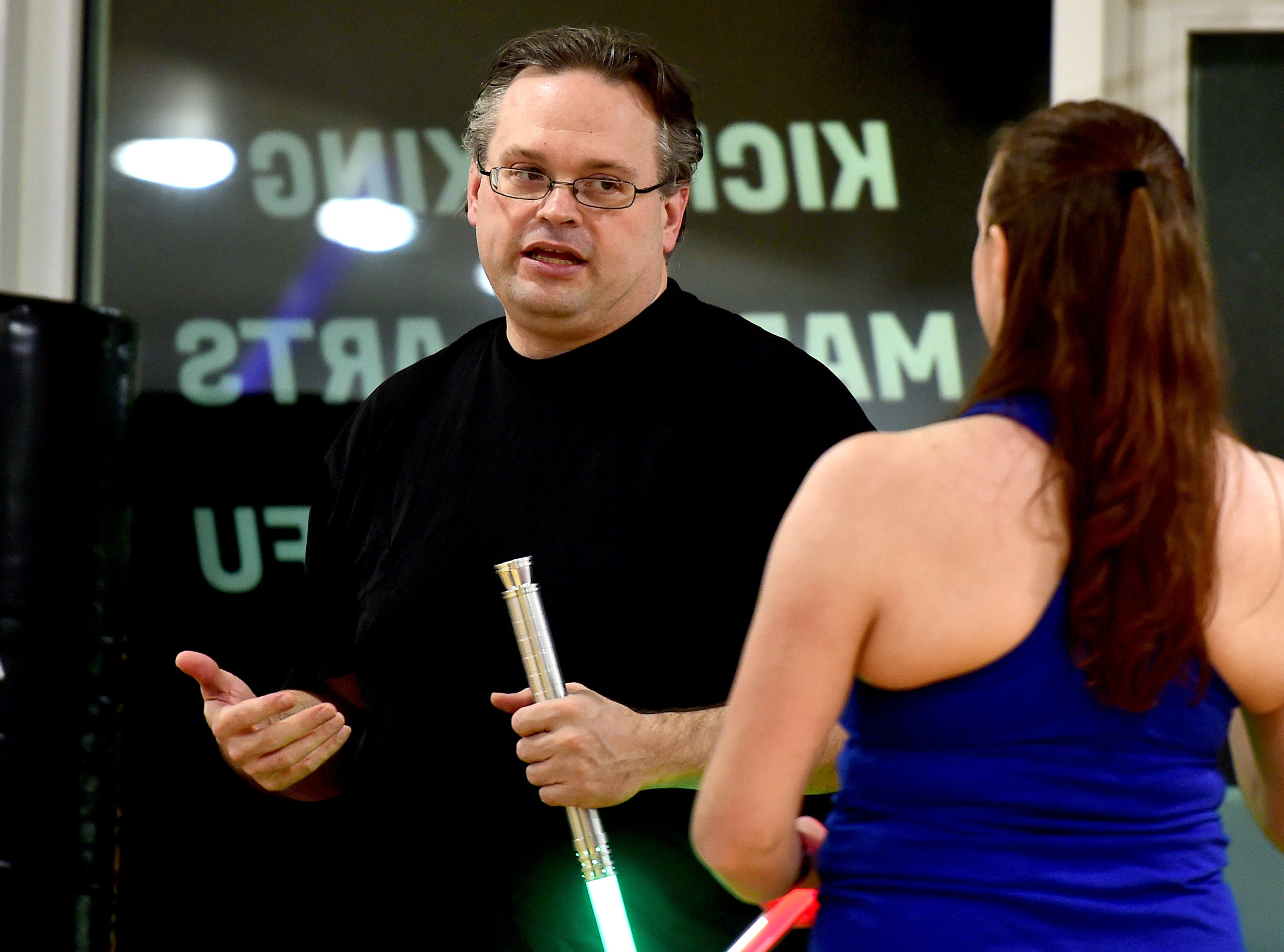 Ithaca Sabers instructor Ben Judkins works with Sarah Ridenour of Danby during the group's weekly lightsaber combat session at Centerline Fitness & Martial Arts in Ithaca.  February 4, 2019.
