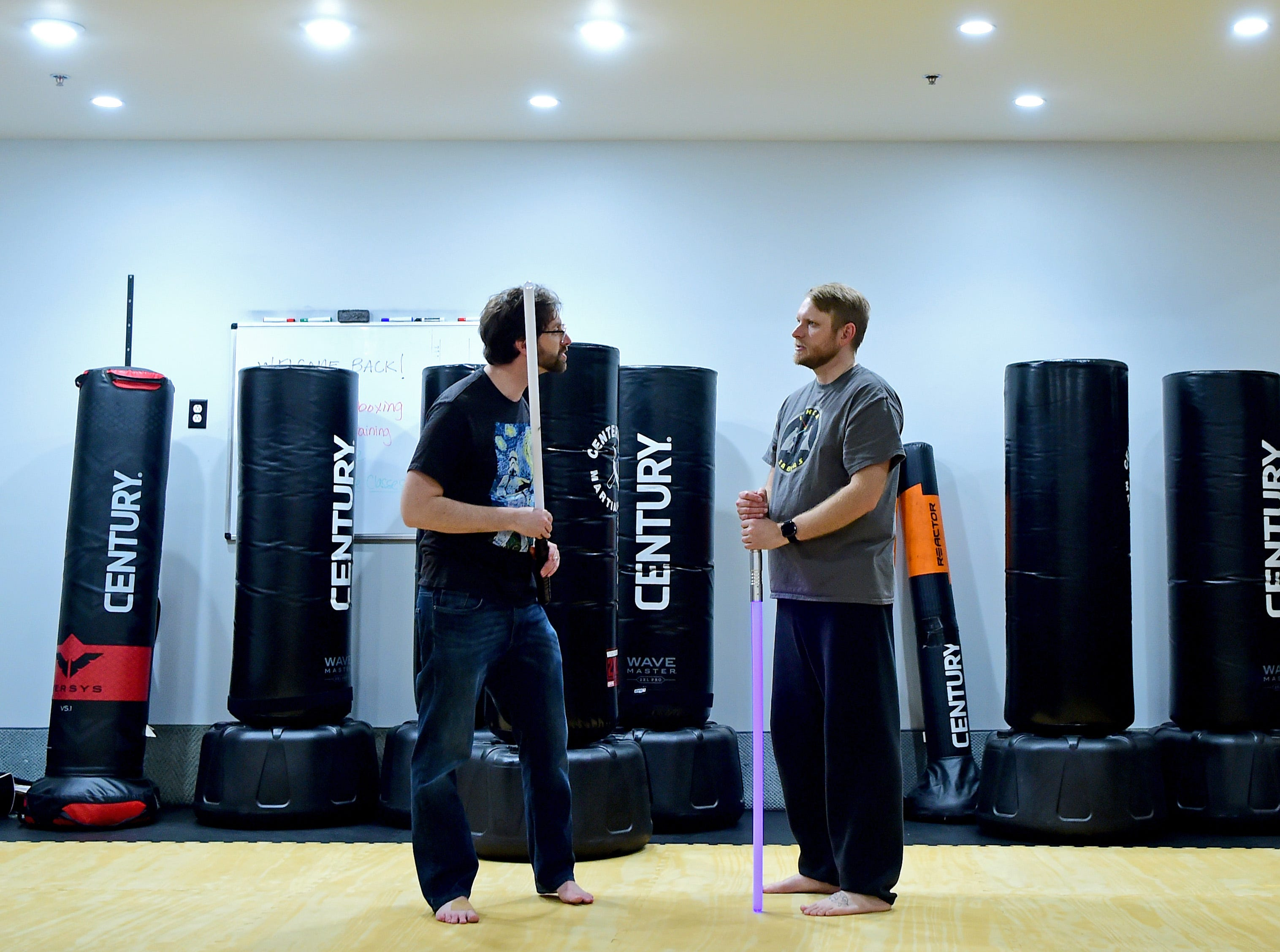 Andrew Hocking, left, of Ithaca, and Terry Gray, right, of Lansing, during the weekly meeting of the Ithaca Sabers at Centerline Fitness & Martial Arts in Ithaca.  February 4, 2019.
