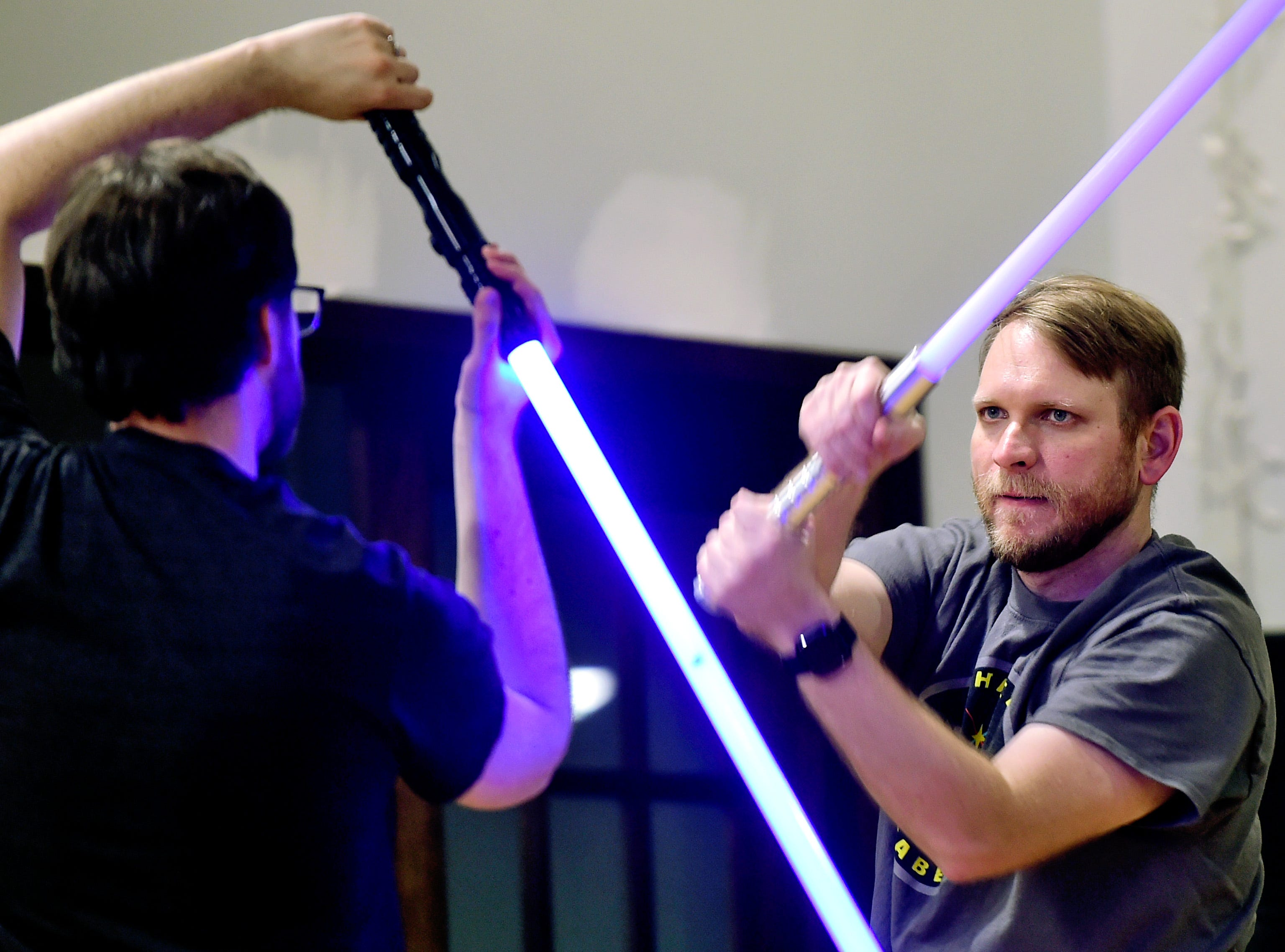 Andrew Hocking, left, of Ithaca, and Terry Gray, right, of Lansing, during the Ithaca Sabers weekly lightsaber combat session at Centerline Fitness & Martial Arts in Ithaca.  February 4, 2019.