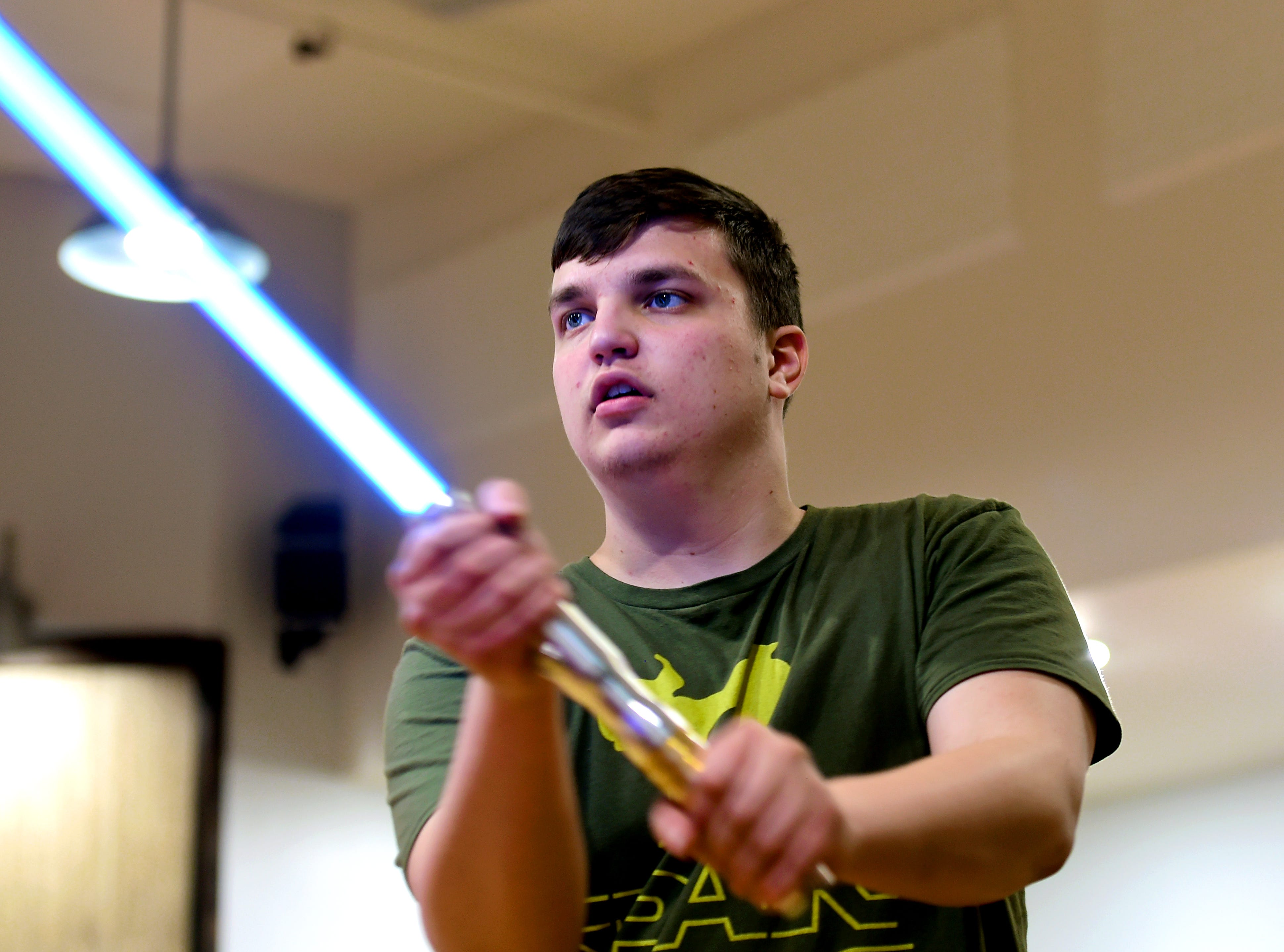 Jacob Cornwell of Van Etten, 12, practices his lightsaber skills at the weekly meeting of the Ithaca Sabers at Centerline Fitness & Martial Arts in Ithaca.  February 4, 2019.