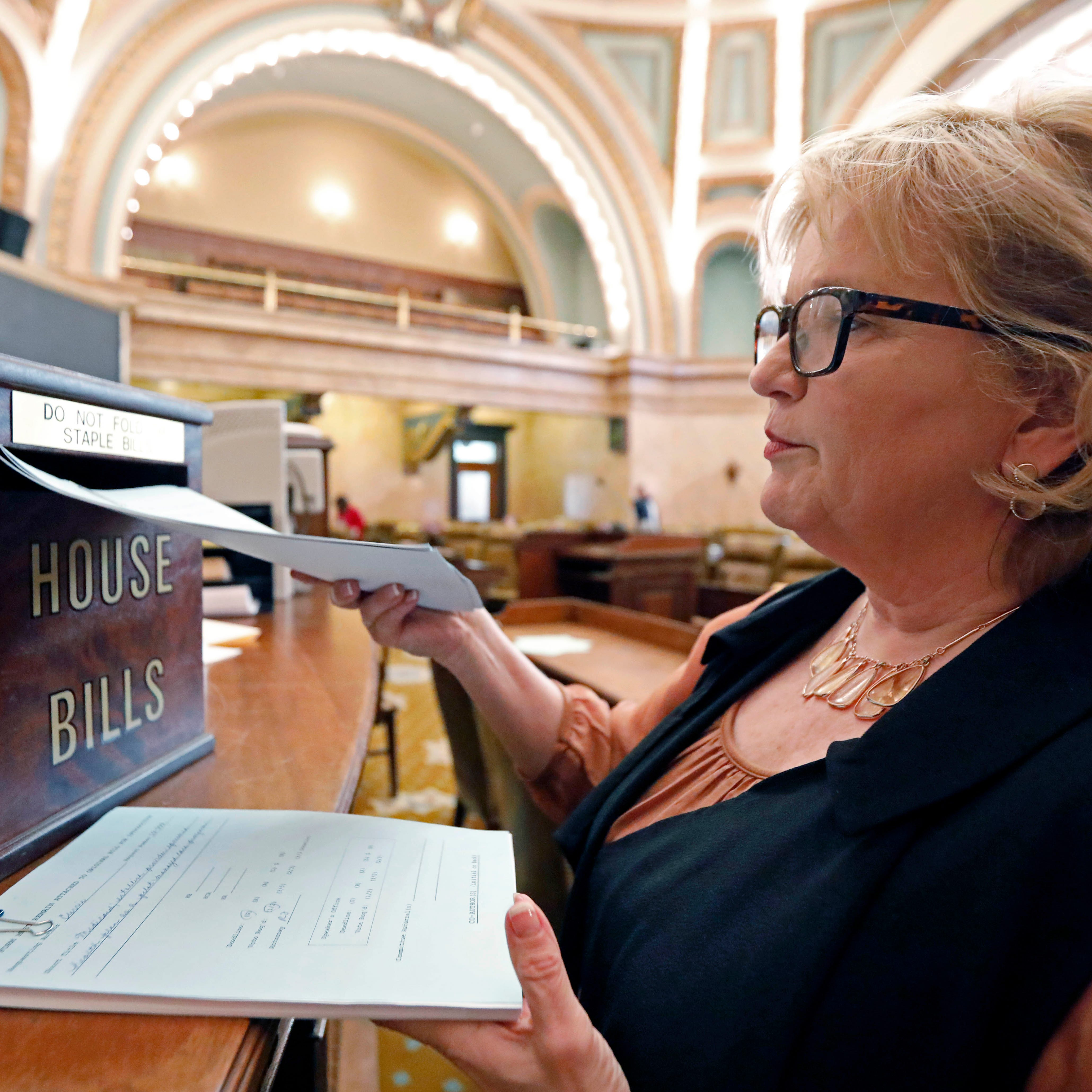 Rep. Becky Currie, R-Brookhaven, files a number of bills in House chambers at the Capitol in Jackson, Miss., Thursday, Jan. 10, 2019. Lawmakers have several days to file proposed legislation before deadline.