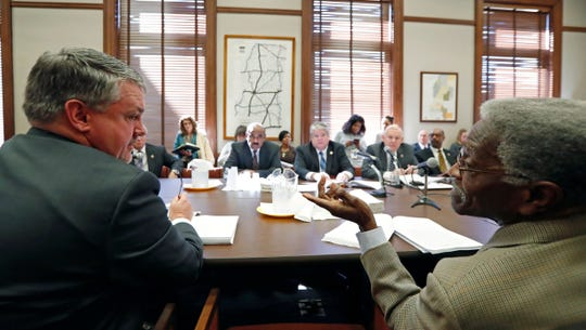 House Education Committee member Charles Busby, R-Pascagoula, left, responds to a question by Rep. Rufus E. Straughter, D-Belzoni, as he presents teacher pay raise legislation, Thursday, Jan. 31, 2019, at the Capitol in Jackson, Miss.