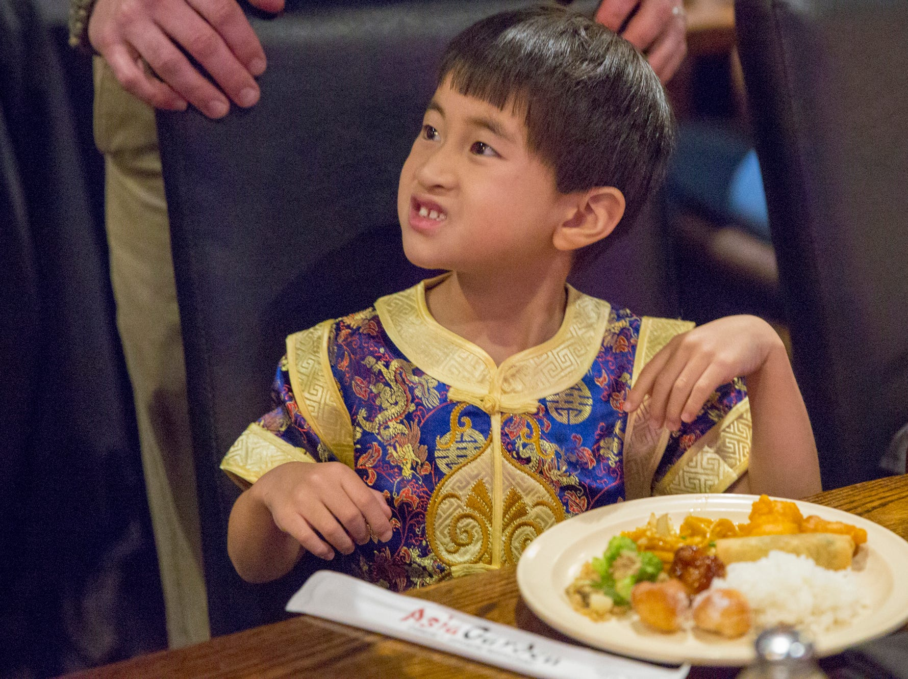 Charlie Nye, 5, looks toward his mom at the Chinese New Year party at Asia Garden Monday, Feb 4,2019