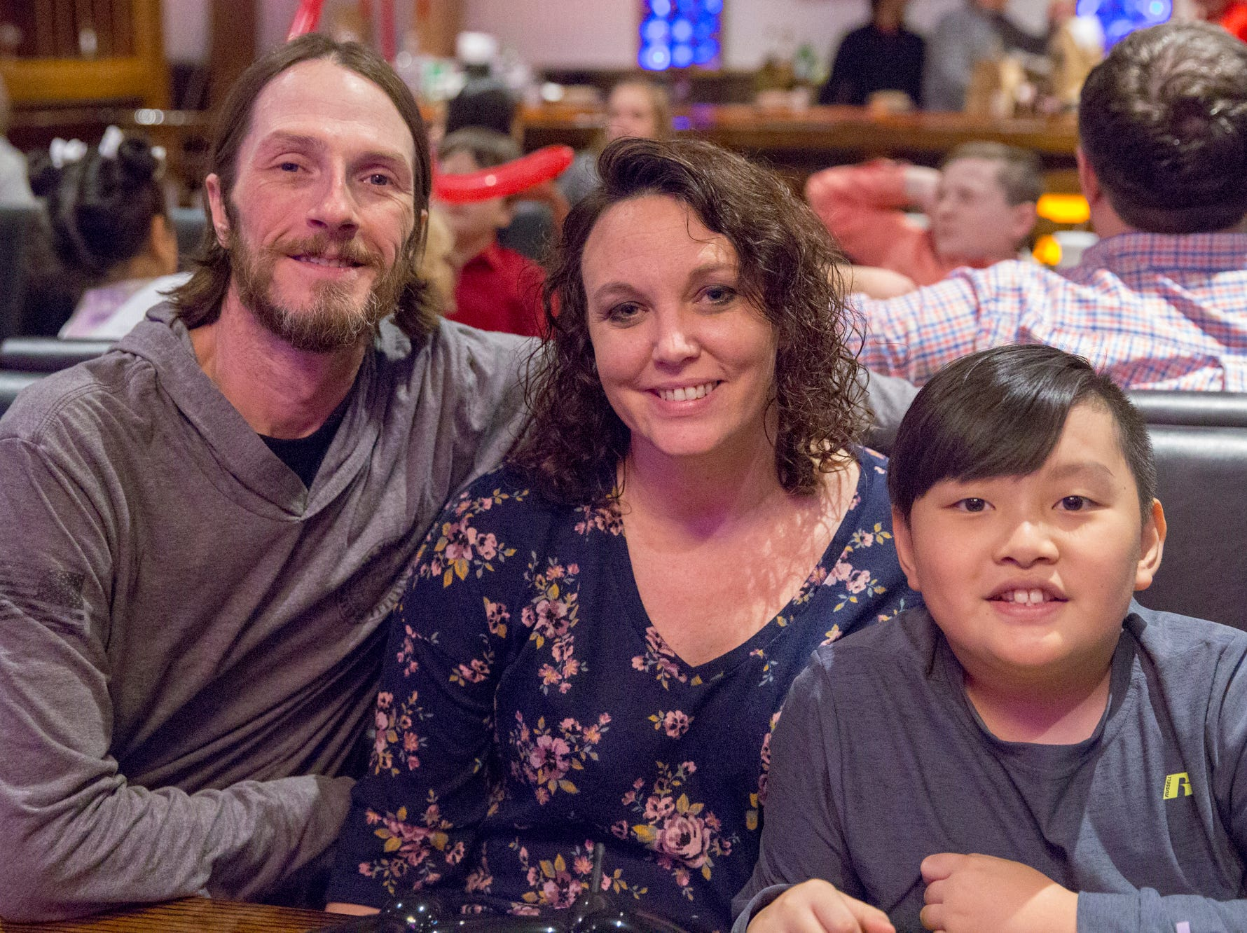 Brian, Melissa, and Brayden Childress.  Brayden is now 10 and was adopted when he was 8 months old.