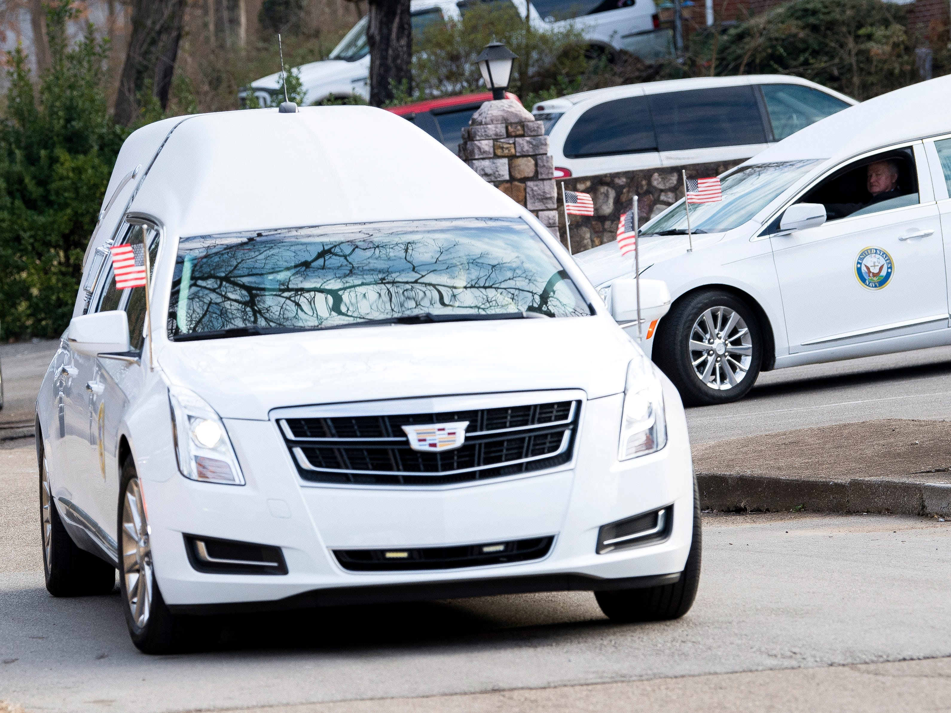 Hearses carrying the urns of seven East Tennessee veterans head toward the East Tennessee Veterans Cemetery on Gov. John Sevier Highway on Tuesday, February 5, 2019.