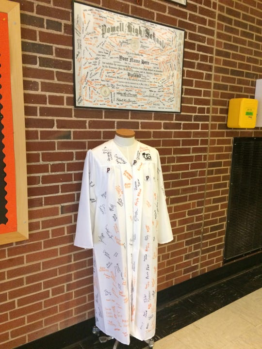 A diploma (signed by sophomores) and a robe (seniors) reminds students that graduation isn't that far away.