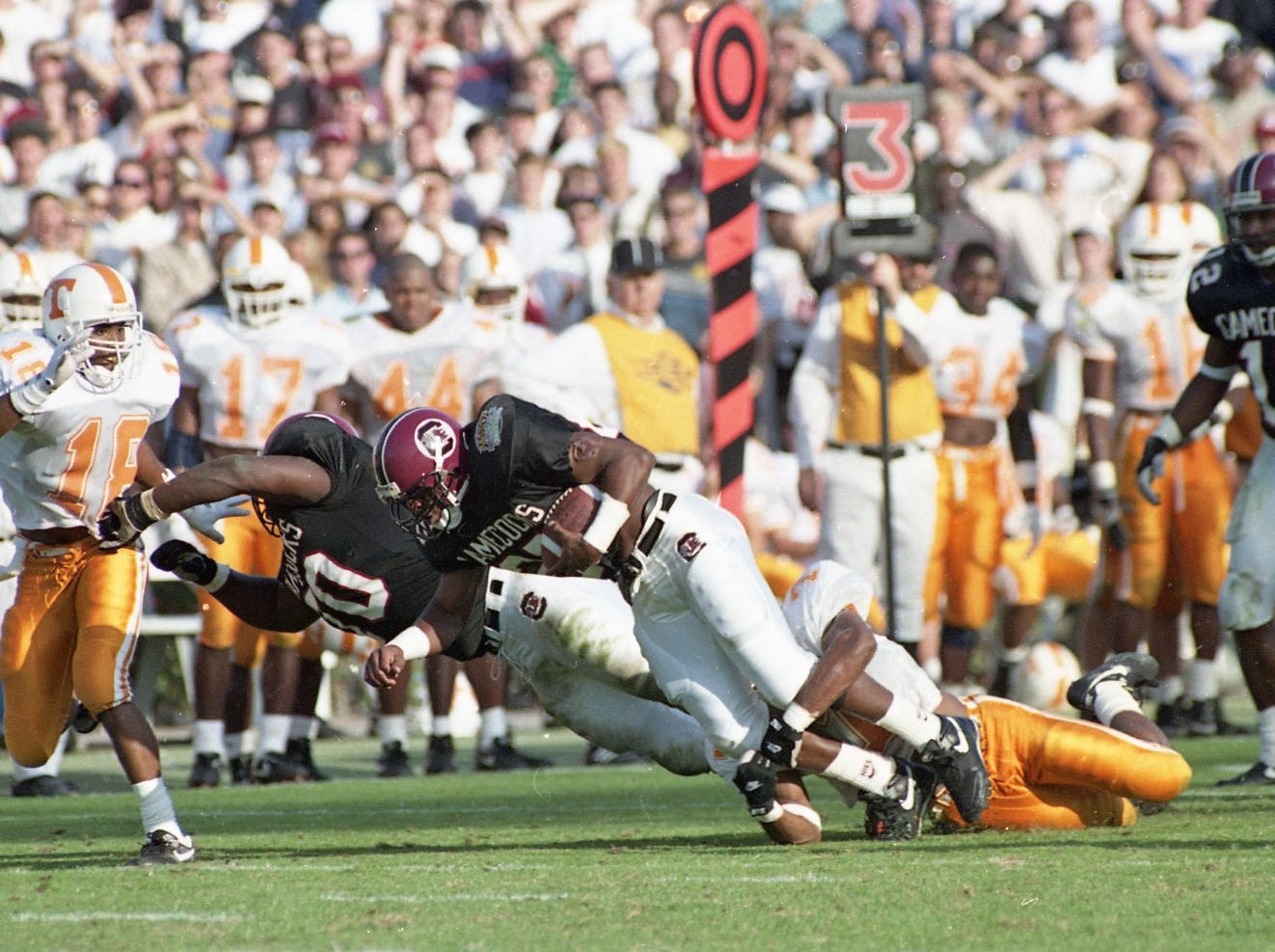 Vol's defensive end DeRon Jenkins (18) closes in on South Carolina running back Rob DeBoer in a 1992 game at South Carolina.