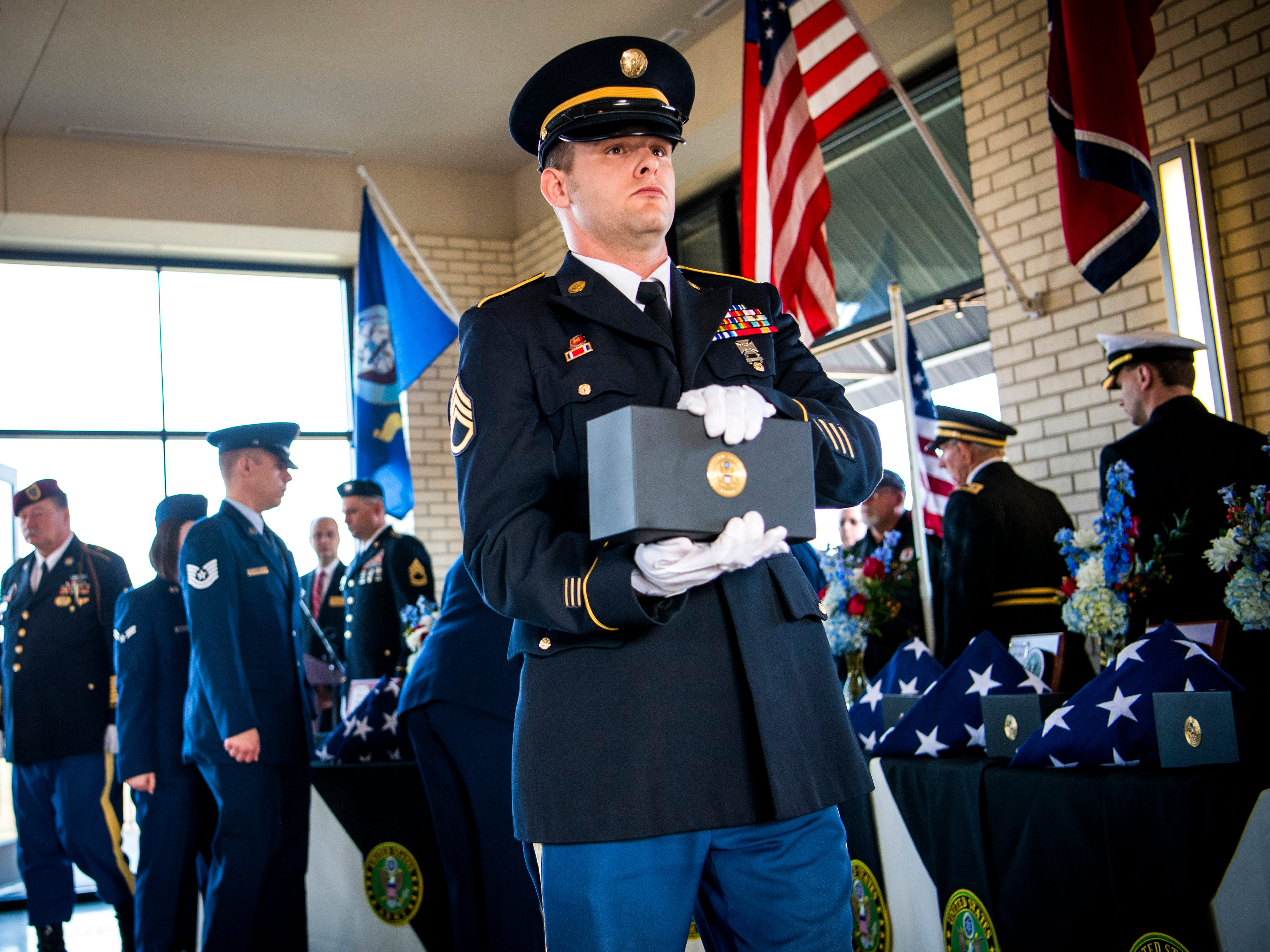 Urns are carried out to the gravesite during a military memorial service for seven East Tennessee veterans held at the East Tennessee Veterans Cemetery on Gov. John Sevier Highway on Tuesday, February 5, 2019.