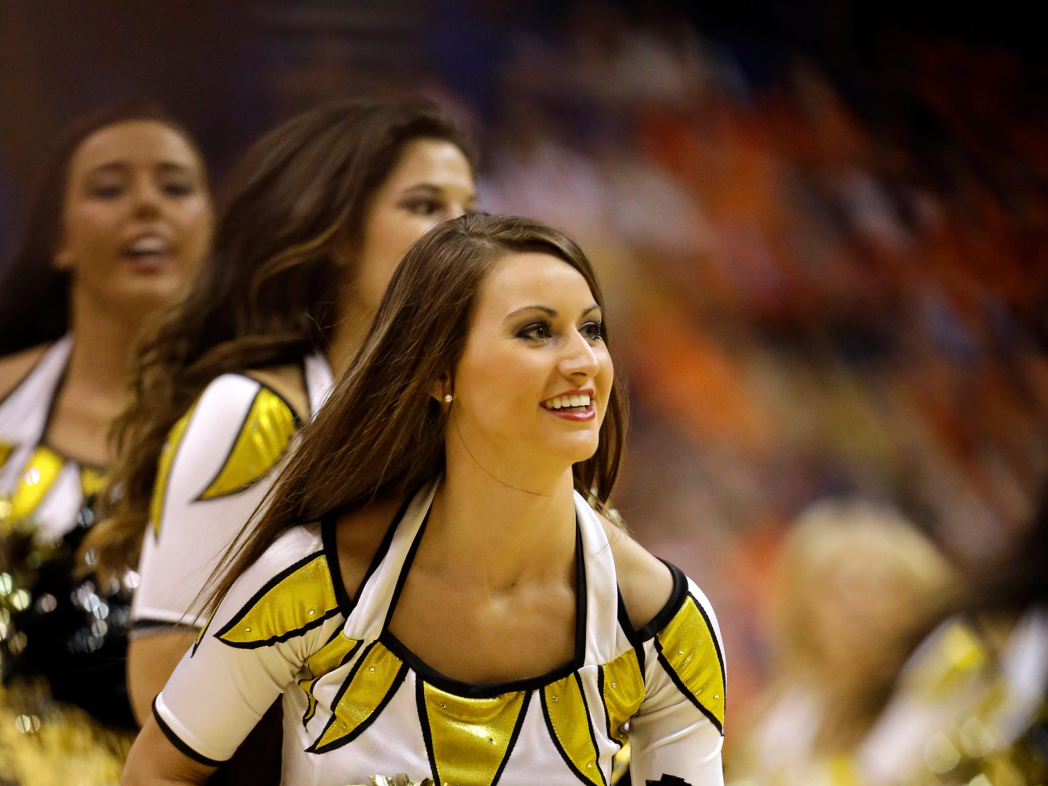 A Missouri cheerleader performs during the second half of an NCAA college basketball game between Missouri and Illinois Wednesday, Dec. 23, 2015, in St. Louis. Illinois won 68-63.