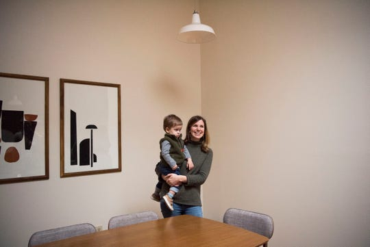 Suzanne Robinson stands in the dining area with her 21-month-old son Duke, at one of 14 short-term rental properties her and her husband manage in their company Knox Staytion, in Old City Tuesday, Feb. 5, 2019.