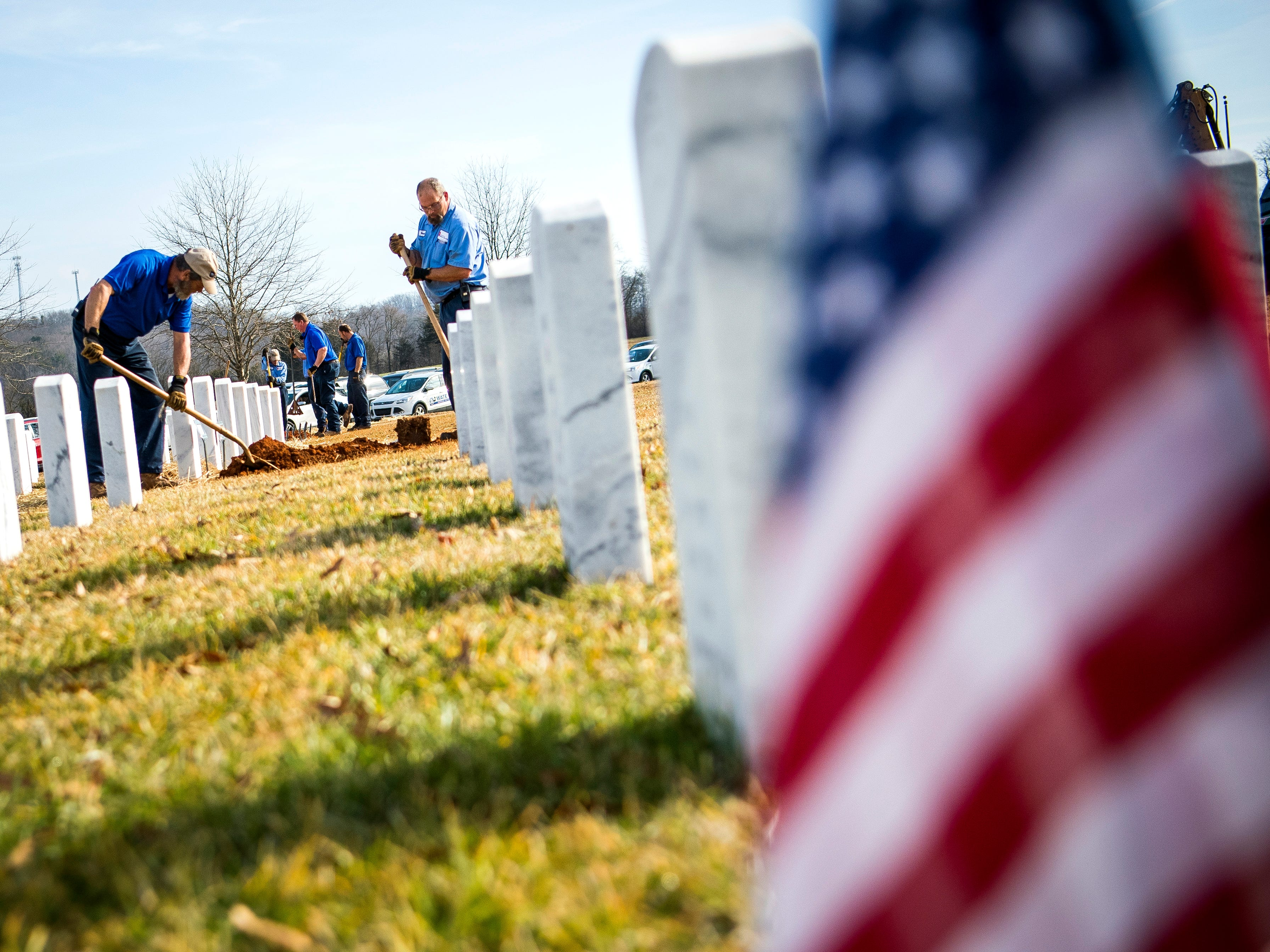 Cemetery workers finish burying the urns after a military memorial service for seven East Tennessee veterans held at the East Tennessee Veterans Cemetery on Gov. John Sevier Highway on Tuesday, February 5, 2019.