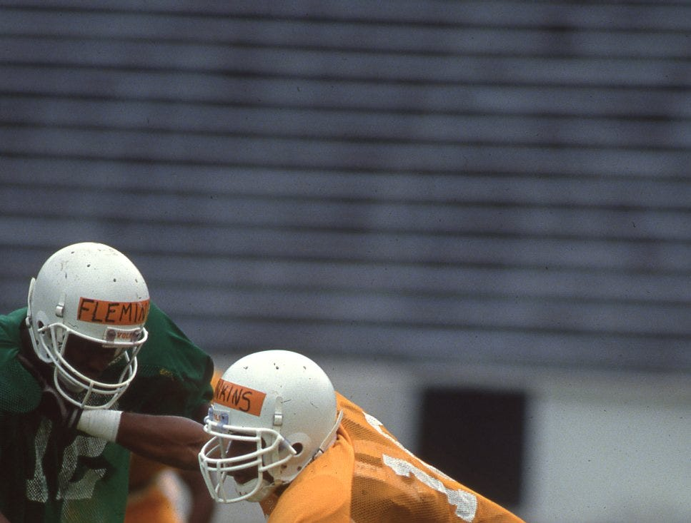 Tennessee cornerback DeRon Jenkins, right, bumps receiver Cory Fleming during a scrimmage at Neyland Stadium, 1993.