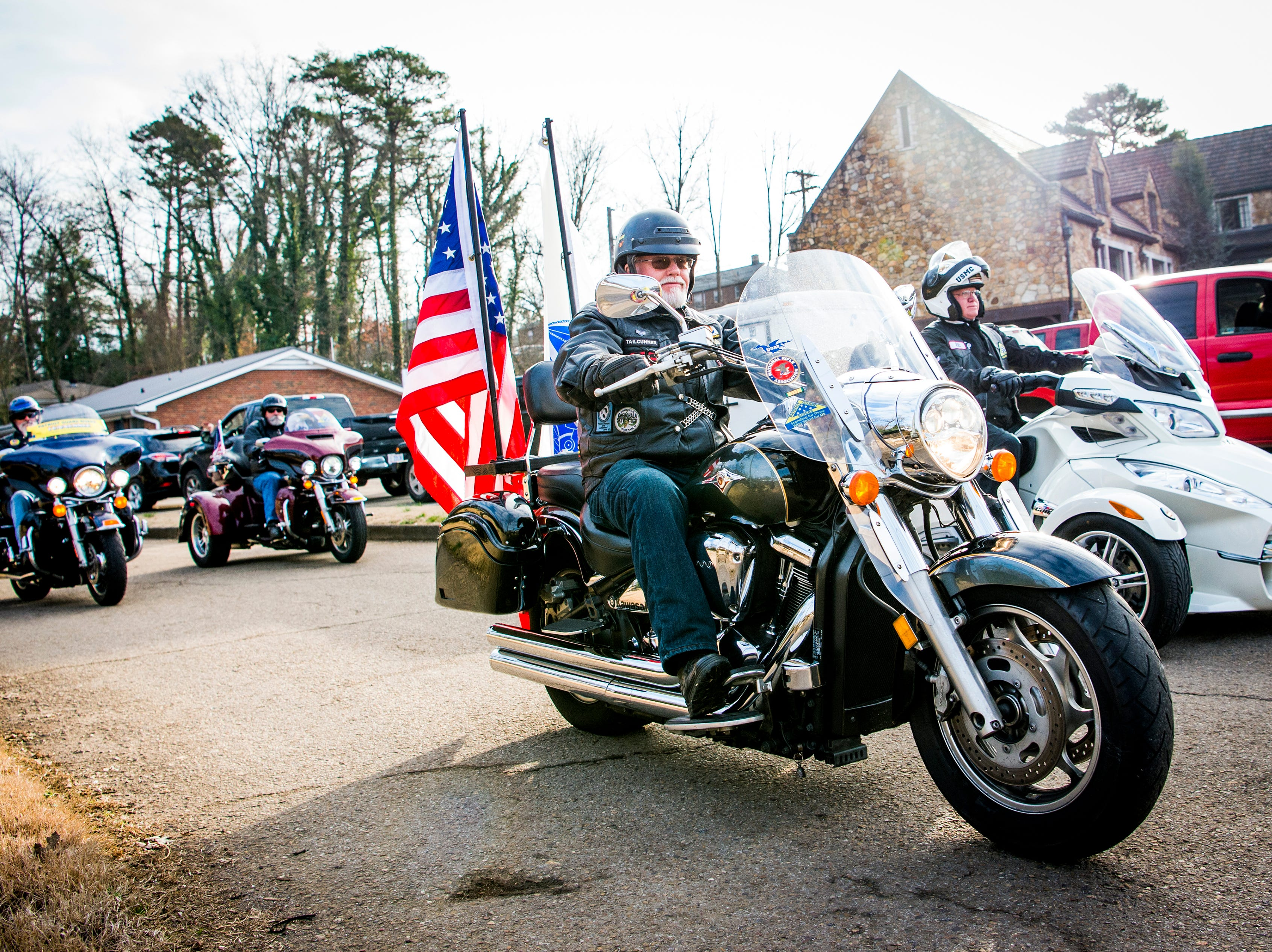 Local veteran motorcycle riders take part in a funeral procession to East Tennessee Veterans Cemetery on Gov. John Sevier Highway for seven East Tennessee veterans on Tuesday, February 5, 2019.